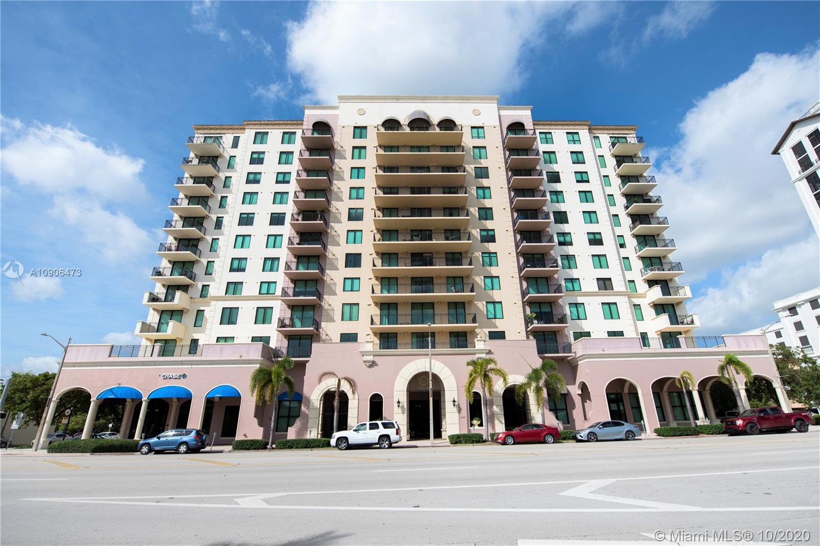 GORGEOUS CONDO IN CORAL GABLES, ONLY BLOCKS OFF MIRACLE MILE AND RIGHT ON PONCE DE LEON. BEAUTIFUL VIEW TO DOWNTOWN BRICKELL. INCLUDES WOOD CABINETS IN KITCHEN AND BATHROOMS, GRANITE COUNTER TOPS IN KITCHEN, MARBLE COUNTER TOPS IN BATHROOMS, ALL STAINLESS  STEEL KITCHEN APPLIANCES, LAMINATED FLOORS IN BEDROOMS IMPACT WINDOWS. 2 PARKING SPACES (ASSIGNED).