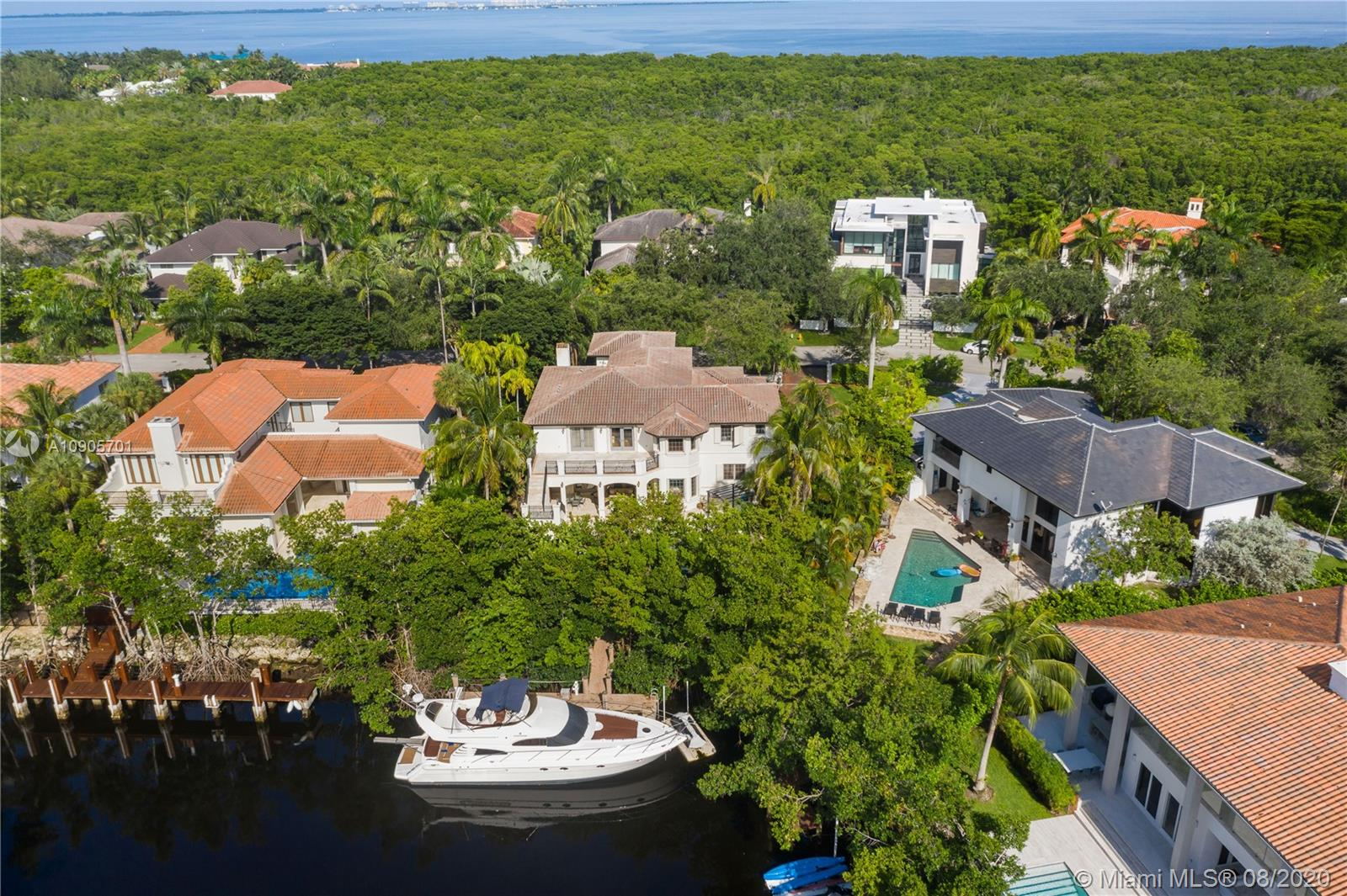 Mediterranean, timeless two-story waterfront in one of Miami's most prestigious neighborhoods. Fits a 60ft yacht,1 bridge to bay, boating double height ceilings, elegant LVG rm & floating staircase, warm finishes from marble, travertine & mahogany finishes throughout; all bedrooms are en-suites, all 7.5 baths are tastefully remodeled, space to add an elevator, chef's kitchen, grand family room opens up to the covered terrace, pristine pool & spa surrounded by lush foliage making an excellent space for private entertainment w/ a tropical pathway to your boat! 2nd floor has 4 suites including the grand master suite w/ expansive terrace & staircase to the pool; 3 car garage & maid's quarters! Cocoplum is a gated 24hr security enclave offering a clubhouse, t-courts, gym, B-ball & a playground!