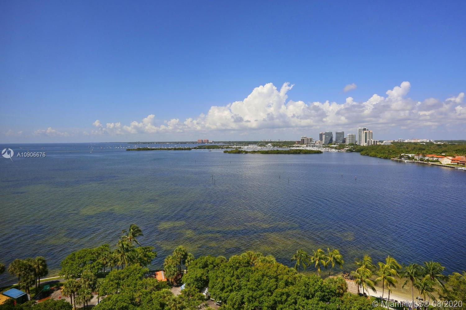 Enjoy unobstructed views of Biscayne Bay and the Grove skyline from this 15th floor residence. Light-filled living spaces open to covered balcony, ideal for enjoying the bay breezes. Updates include travertine flooring & custom built-ins throughout. Stunning kitchen feature European-style cabinetry, quartz countertops & top-of-the-line appliances including wine storage. Large master suite with walk-in closet & luxurious bath w/ soaking tub and glass-enclosed shower. First-class building amenities include concierge, on-site restaurants, 14 Har-Tru tennis courts, marina, private beach, jogging path, spa, fitness center & heated pool. Just across the bridge from the Grove village center's galleries, boutiques and cafes. Minutes to downtown, MIA and the Beaches.