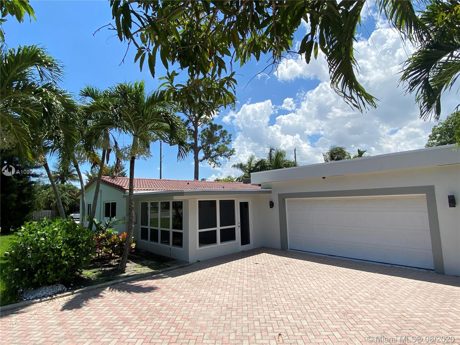 Beautiful Updated Home In A Great Location.. Short Walk To Wilton Drive..Home Features Impact Windows And Doors, New Modern Bathrooms, New Tile Floors, Recessed Lighting, New Kitchen Appliances, Fresh Paint, Barrel Tile Roof Just 8 Years Old,Flat Roof 2 Years Old,Main A/C 4 Years, Second A/C 1 Year,Oversized 2 Car Garage, Large Concrete Area Next To Garage is Perfect For RV Or Boat Storage. Pavers Driveway Can Accommodate  4 Or More Cars. Large 10,721 SF Lot, Amazing Family Room Measures 39 Foot Long By 13.5 Foot Wide