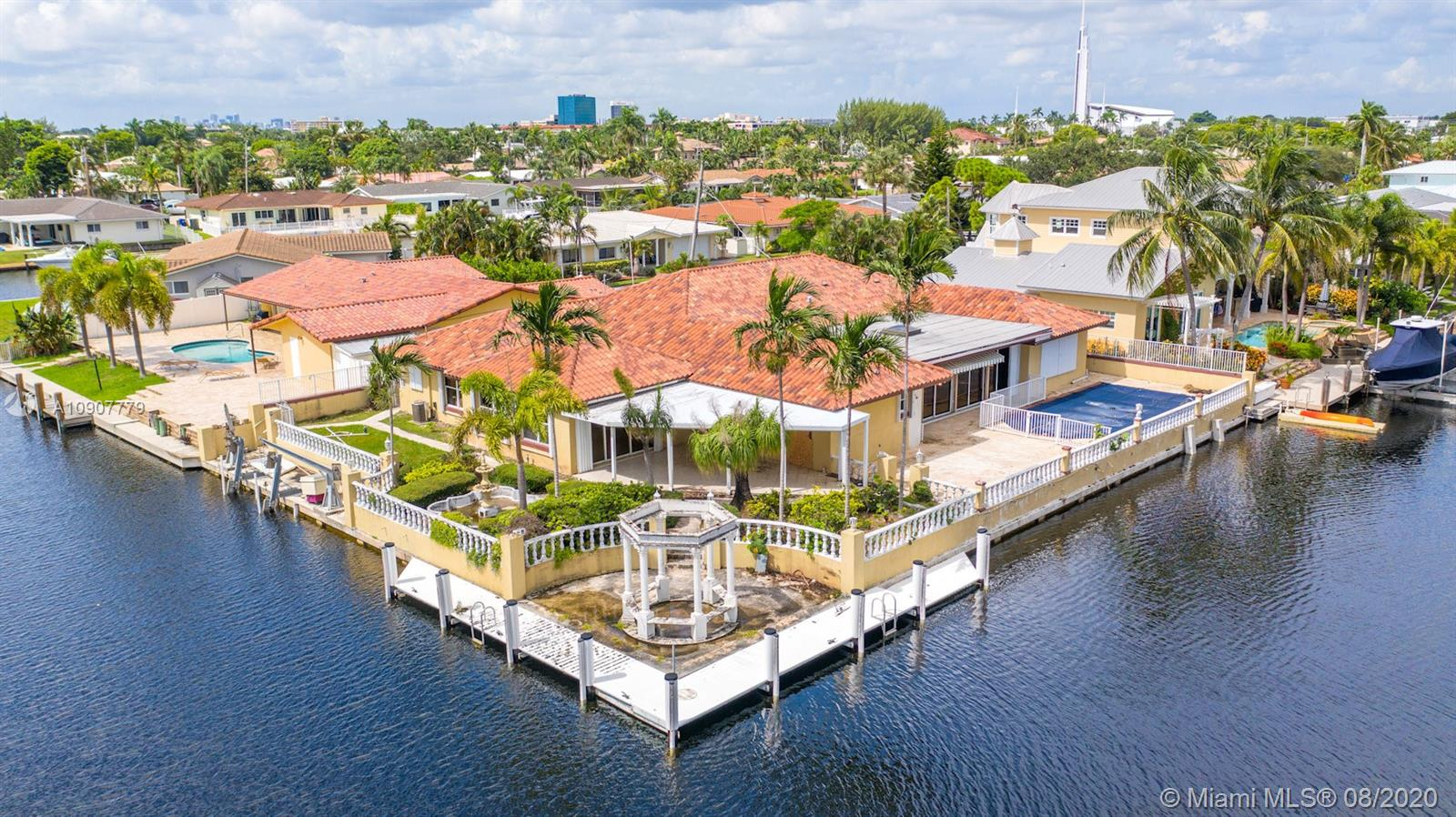 EXTREMELY DESIRABLE and RARELY AVAILABLE 205'ft wf point lot in an amazing location in much desired Ft Laud! Boater's dream location, location, location w/ocean access at an almost unheard of asking price! 5 br 4.5 ba, 2 car gar, media rm, skylight in lg sun rm, marble bath, fireplace and lovely  Marble flooring in liv rm, formal din rm, foyer, marble accents throughout. Very large master walk-in closet. 4,147 sf under air. PROPERTY SOLD AS-IS. NO REPAIRS NO REPAIR CREDITS. Seawall and pool needs repair buyer is responsible to verify property, pool, seawall, dock system condition, permits and/or code compliance and/or violations and liens and must take subject to municipal requirements and liens or fines due (if any exist) Lien amounts not known at this time.