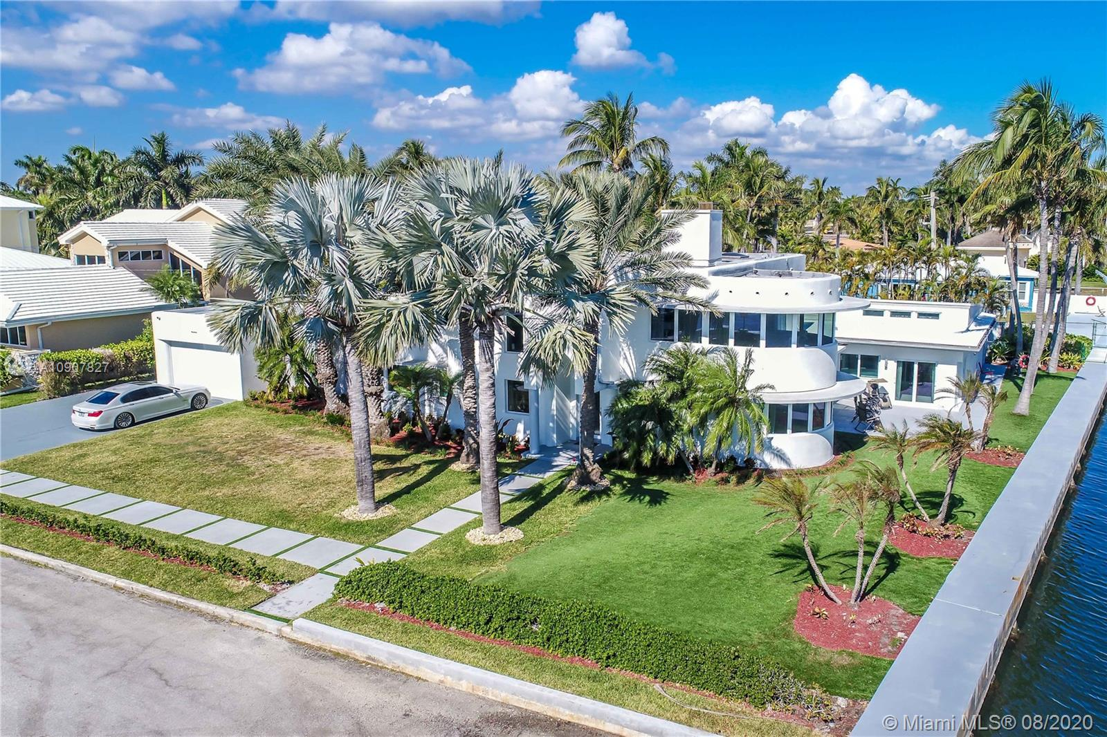 Just Reduced! PERFECT SHORT TERM RENTAL AIR B AND B. STUNNING DIRECT INTRACOASTAL WATERFRONT ESTATE WITH BOAT DOCK AND 16KLB LIFT ON DEEP WATER WITH NO FIXED BRIDGES. PROFESSIONALLY DESIGNED MASTERPIECE IN HOLLYWOOD LAKES. 2 MASTER SUITES UPSTAIRS AND 3 BEDROOMS DOWNSTAIRS. IMPACT DOORS AND WINDOWS. BEAUTIFUL WATERFRONT SETTING. VERY UNIQUE INDOOR HEATED POOL WITH A FULL BATH. WINE CELLAR~OPEN FLOORPAN~STAINLESS STEEL AND WOOD STAIRCASE~SCENIC VIEWS EVERYWHERE COMPLETE WITH AN OCEAN VIEW FROM THE MASTER BEDROOM. NEW KITCHEN WITH EUROPEAN CABINETS, WATERFORD QUARTZ COUNTERTOPS, VIKING APPLIANCES~FORMAL DINING~BAR AREA GREAT FOR ENTERTAINING~ONE BEDROOM DOWNSTAIRS CAN BE USED AS CABANA, Easy to show, will not last. Perfect location for an AIR B AND B PROPERTY