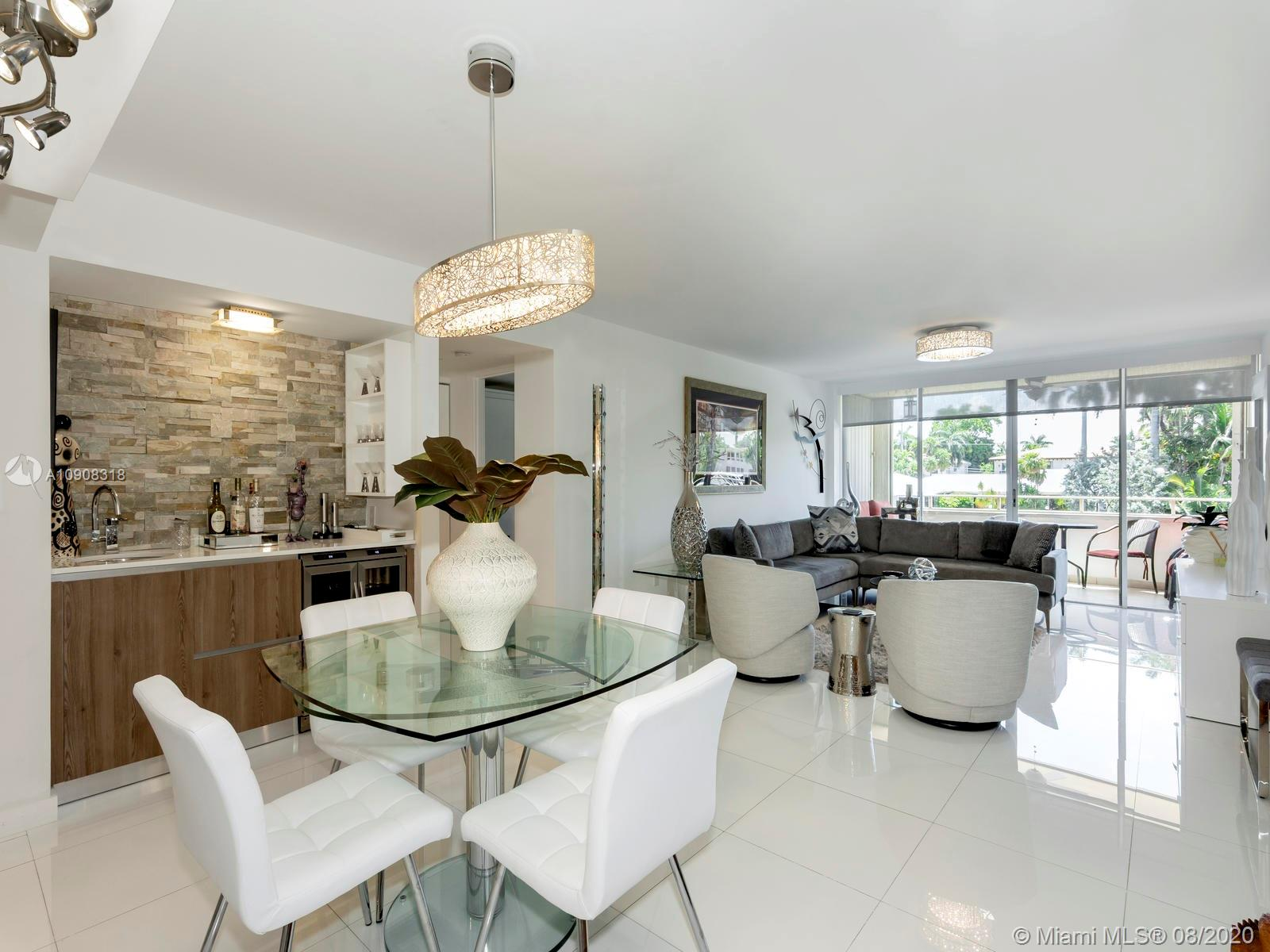 Stunning renovated and spacious 2 bedrooms / 2 baths condo with direct water views and large balcony overlooking the intracoastal in highly desirable Bay Harbor Islands. Building sits on the canal & features zen style lobby, relaxing water front pool with bbq area, gym and sauna. Excellent location only minutes to Bal Harbour Shops, dining, beaches and A+ rated schools.