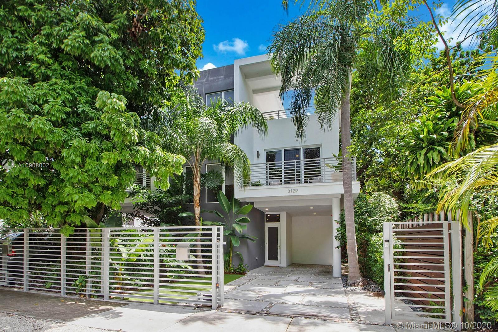 Immaculately designed contemporary Coconut Grove townhouse on adored Matilda Street. This modern newer construction residence has everything you have dreamed of for your new home! Functional  spacious layout with custom built ins and soaring vaulted ceilings. Banks of impact glass doors open to the private swimming pool. Designer finishes throughout reminiscent of multiple million dollar estates. Chill and relax on your own private roof top terrace surrounded by native foliage. Retreat to your very own Sanctuary in the urban Grove neighborhood in the heart of Miami. You even have your very own putting green to practice some golf! From every window you see lush green foliage. Gated entry way with a separate pedestrian entrance make walkability easy to the parks, cafes, CocoWalk and Marinas.