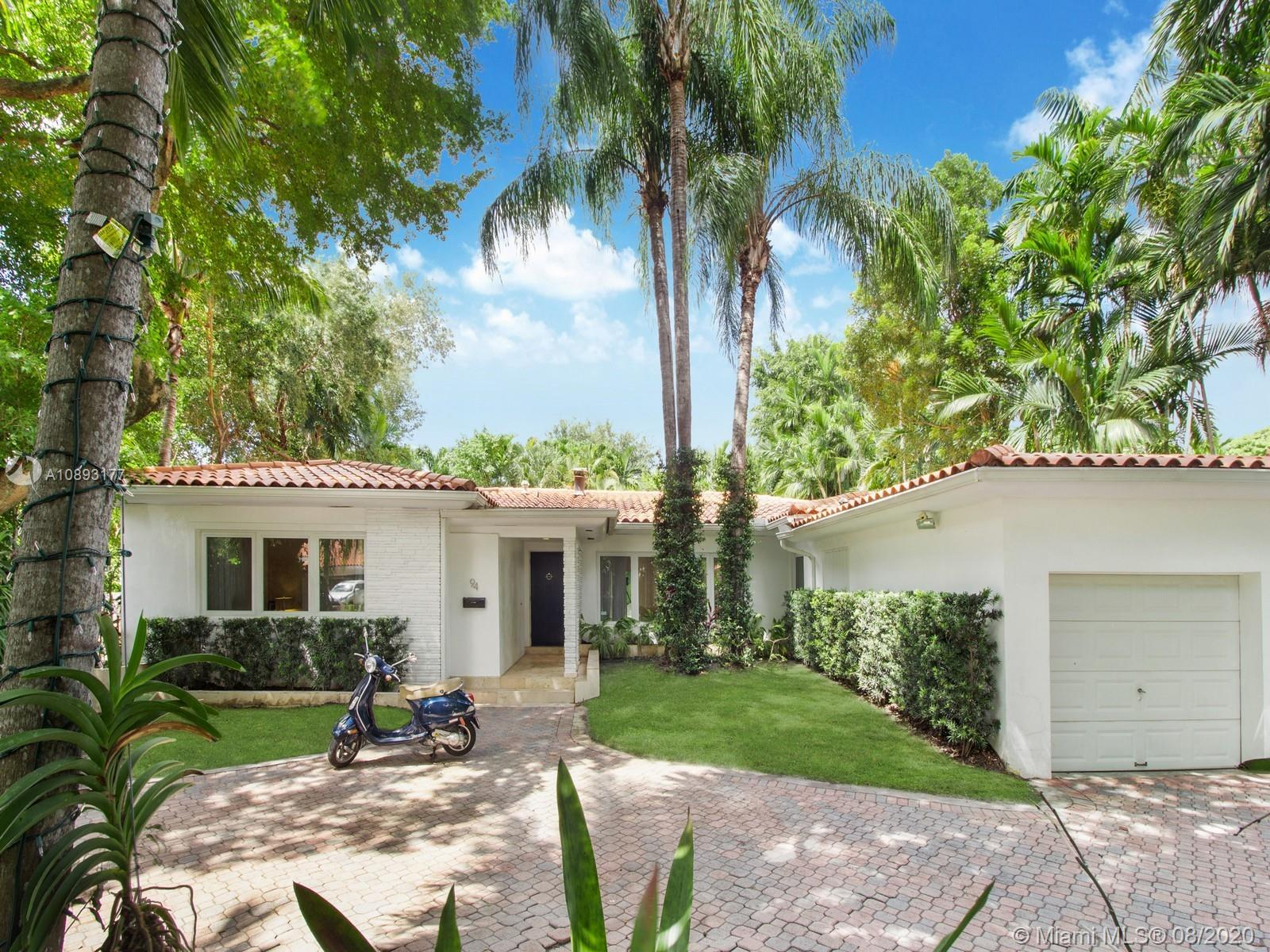 The best opportunity to own in Bay Heights on an oversized lot with a gracious interior layout and flexible spaces. Updated with designer wall coverings, contemporary bathrooms and custom built-ins. Gorgeous hardwood and travertine marble flooring throughout the entire home. Banks of impact doors in the family room open up to the modern covered veranda and swimming pool area. Garage converted to nanny's quarters and serves as the 4th bedroom and 4th bathroom. This superb Coconut Grove community offers a private police patrol 24/7 without any mandatory association dues as well as not in a flood zone. Family friendly neighborhood with sidewalks perfect for walking or kids riding bikes. Live only minutes away from downtown Brickell, Miami Beach and Key Biscayne.