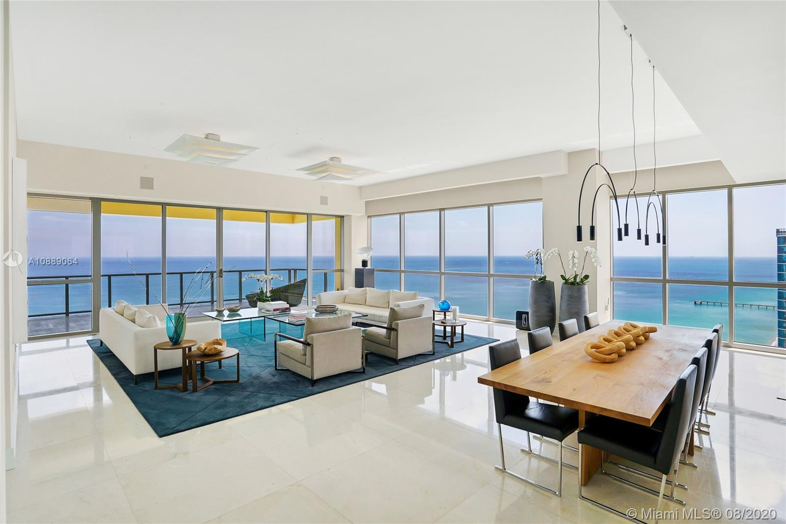 """STEP INSIDE TO THE MOST LUXURIOUS TOWER IN SUNNY ISLE,  MANSIONS OF ACQUALINA, THIS FULLY TURNKEY  RESIDENCE #3202 BRING ONLY YOUR TOOTHBRUSH, HAS ENDLESS SOUTH & NORTH COASTLINE VIEWS OF THE OCEAN AND OVER LOOKS TOWARDS DOWNTOWN FROM THE WEST BALCONIES.  BREATHTAKING BEAUTIFUL ATTENTION TO DETAIL FEATURING 4609 SQ.FT 3BED PLUS FAMILY PLUS SERVICE & 6.5 BATHS, DIRECT OCEANFRONT, HAS PREFERRED SOUTHERN EXPOSURE, INCLUDING PRIVATE JACUZZI, &OUTDOOR SUMMER KITCHEN.  PRIVATE ENTRY FOYER WITH 12FT CEILINGS, SPACIOUS LIVING AREA & MASTER SUITE, INCLUDES HIS & HER MASTER BATHS, FIREPLACE & MORE.  ENJOY 5 STAR AMENITY SERVICES  INCLUDES A """"ROLLS ROYCE HOUSE CAR, COMPLIMENTARY BREAKFAST , FULL HAMMAM , SPA, BEACH CLUB SERVICES, YOGA, CIGAR LOUNGE,  LUXURY CONDO LIVING AT ITS BEST IN SOUTH FLORIDA."""