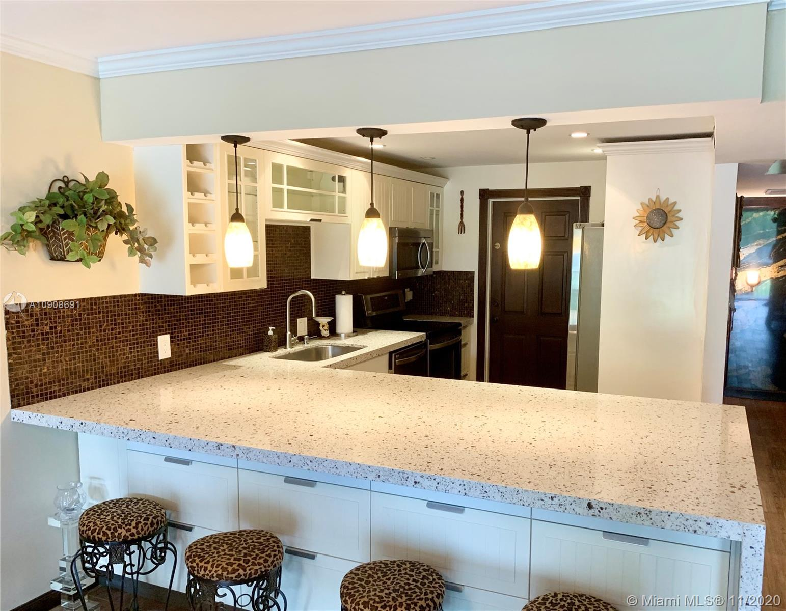 Beautiful corner completely remodeled apartment in Palm Aire Country Club. 3 bedrooms, 2 bathrooms, all tiled, open kitchen, stainless steel appliances,  crown molding, golf view, very bright unit with lots of closet space. Building is walking distance to main street. Association has 3 pools. Near shops, restaurants, main highways and beaches.
