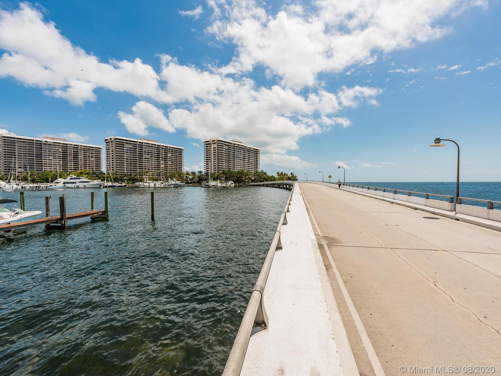 Live in a resort!! Grove Isle is resort living at it's best! Beautiful bay and city views!  This is a sizable unit that features  2 bedroom, 2 bath,  lots of natural light, and plenty space, large closets and storage.
