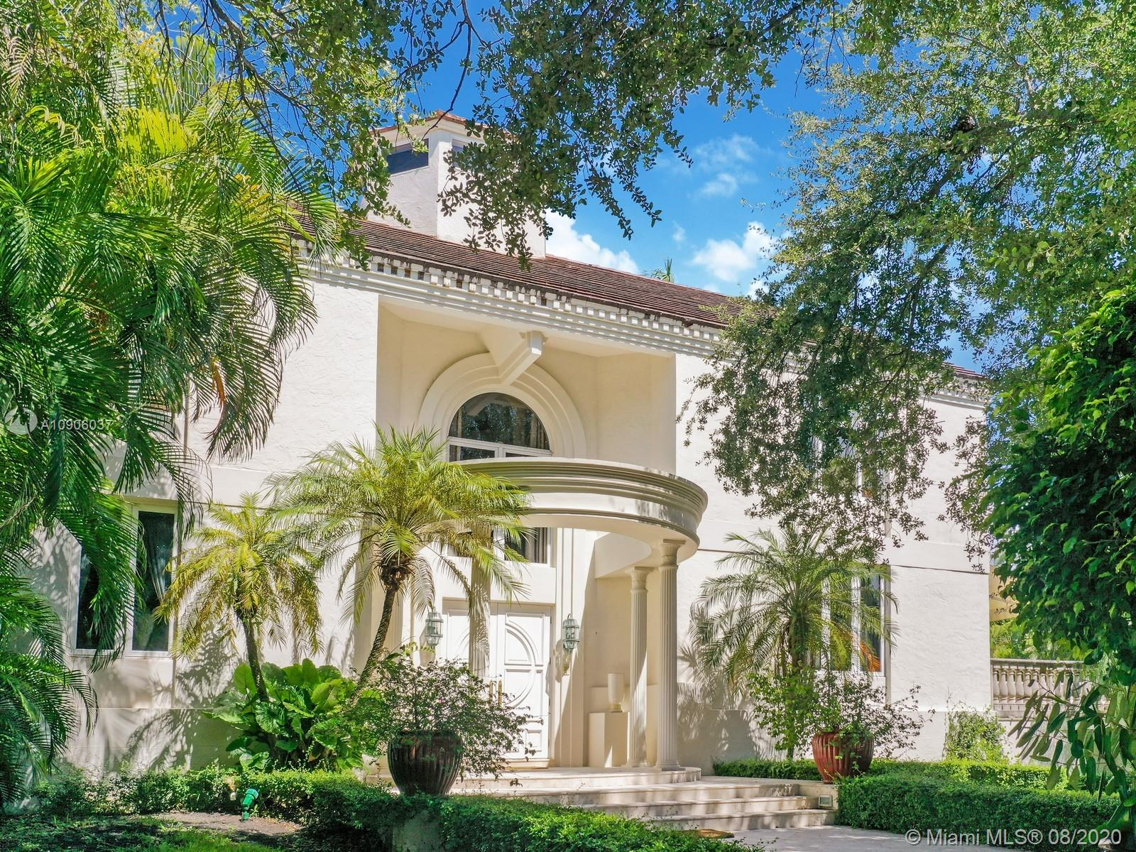 Just a block from media mogul Pharell's new $30 million Miami bunker, this gradiose tri-level Mediterrenean style estate sits center spot on an oversized lot with beautiful north and south views of its curated garden landscapes. Totally renovated with custom work throughout, from the wood inlaid marble floors to the designer chandelier, the built-in cabinetry to the fitted drapes, the interiors of this home perfectly accentuate its beautiful exteriors. The floor to double ceiling windows fill the home with natural light, but the floorplan layout of this trophy property makes it truly unique and perfect for both private, grand entertainment and a beautiful lifestyle. A MUST SEE!! 3D walkthrough and video available. Contact listing agent for more information.