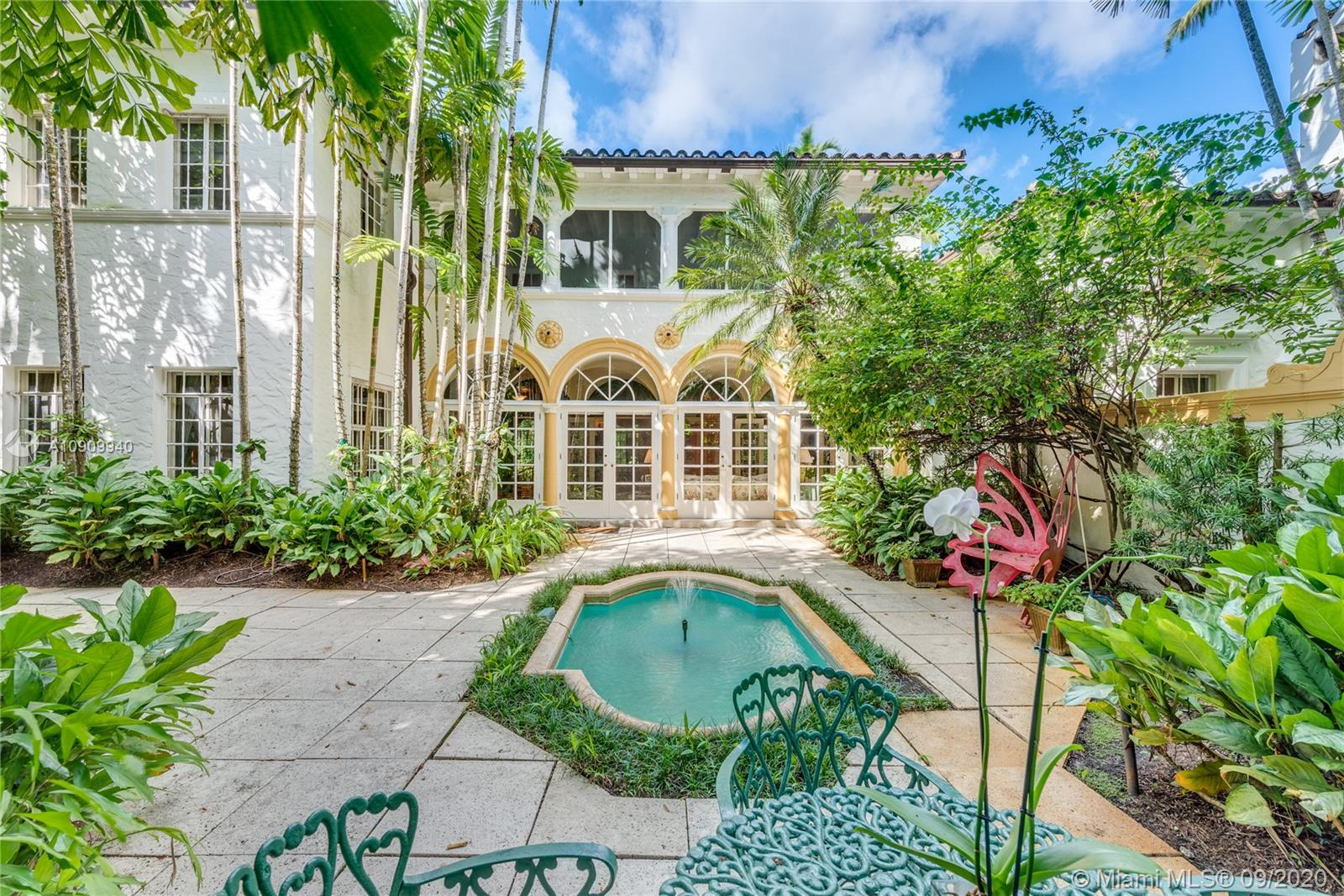 This classic 1926 Mediterranean villa is a crown jewel of Coral Gables. Nearly 5,000 adj. sq. ft. on a 17,500 sq. ft. lot. Steps from the Granada Golf Course. Enter to a large foyer with a sweeping staircase/marble floors. Entertain on a grand scale in a 45' ballroom with fireplace, or in the baronial LR with 12' high coffered ceilings. The 34' Garden room opens through French doors to the tranquil courtyard with fountain/patio (room for a pool). Formal DR next to a huge kitchen/breakfast rm. Half bath tucked under the stairs. 2-car garage. Upstairs Master Suite has a fireplace, sitting room, walk-in closet. Also, find 4 spacious bdrms/2 baths, plus screened-in porch overlooking tropical landscaping. This Merrick-era Mansion is unique and exquisite in every detail. Well priced.