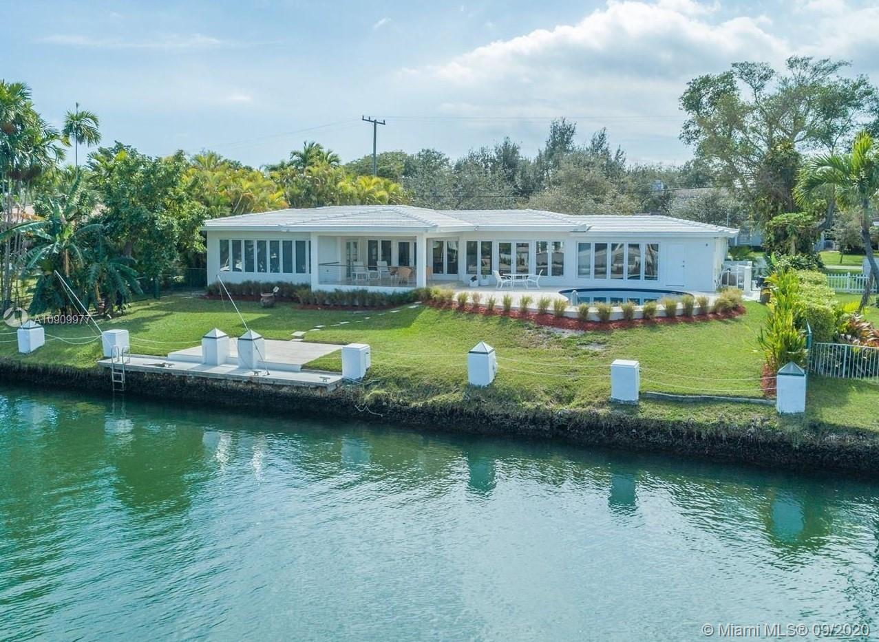 """3,800 actual sf approx....""""Waterfront Home Fully Remodeled, Impact Windows and doors overlooking the IntraCoastal and the beautiful Pool with the garden full of fruit trees. Open spaces w/bright interiors, beautiful and huge New seamless custom kitchen with double oven, lots of cabinets and pantries, eat-in island. Dining area framed by expansive water views & open to the covered terrace & pool. All bedrooms en-suite with walk in closets and master suite with panoramic waterway views. The lawn slopes down to private dock on 105 ft of water frontage. 2 New A/C units, Nest thermostat system, ADT security system, Sonos sound system throughout. New grilling pavillion with Bull gas grill and Big Green Egg. Come and see this jewel before it gets sold."""
