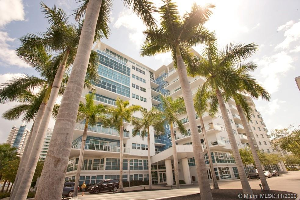 Best of both worlds!!! All the benefits & amenities of community living but the privacy of a single family home. Luxurious two story lanai with private dedicated entrance at the fabulous guard gated Aqua, Allison Island. 2 bedroom 2 baths upstairs with 1/2 guest powder room on ground level. Custom riverstone wall, built ins, closets, marble floors, wine cooler & custom lighting! Expansive lushly landscaped palm tree lined outdoor living area deck with stone patio perfect for entertaining, kids & pets. Aqua amenities include 6,000 SqFt fitness center / spa, 2 heated saltwater pools, children's play center, business center, event room, 1/2 mile waterfront promenade & on-site convenience store..