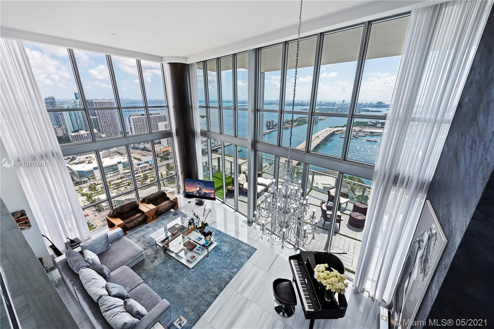 Majestic & unique combined condo units in the hottest location in Downtown Miami. No expense spared in this nearly 7,000 SF luxury property in the iconic Marquis Miami Residence. A total of 3 combined residences, this corner condo features 6 beds, 6 baths & 2 half baths, movie theater room, office, two laundry rooms, oversized terrace space and 4 assigned garage spaces. Master bedroom features a double shower, jacuzzi & sauna. Savant home automation system with Sonos audio throughout and fully electric window treatments. The main event is the unobstructed breathtaking views of Biscayne Bay, Atlantic Ocean, Miami Beach & Downtown Miami. Located minutes to sports & cultural venues. 5-Star Marquis amenities with 24-security, brand new gym, yoga studio, kid's playground and world-class pools.