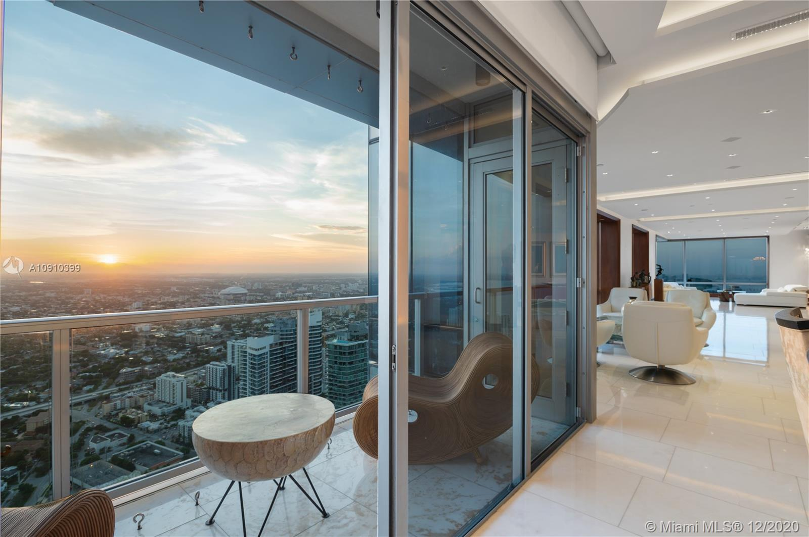 On Jan 29, this 70th-floor penthouse will be sold at Luxury AUCTION® WITHOUT RESERVE! List price for REFERENCE ONLY. Offered with Platinum Luxury Auctions. Welcome to exquisite living! From corner to corner of the Four Seasons, this expansive unit offers 180 degree vistas of Key Biscayne, Biscayne Bay, & the lights of the Magic City; captivating views from anywhere in the unit, magnificent sunsets! 3 units combined create 6,000+/- SF of palatial living. Lapis Lazuli Snaidero kitchen w/ Miele appliances; floating Onyx bar w/ temp-controlled wine storage; 2 balconies; oversized master, his/hers walk-in custom closets; $1 million+ in custom woodwork. 4 parking spaces, 6 Equinox memberships & all the 5-star amenities & world-class service of the iconic Four Seasons. Marketed by Techrin Hijazi.