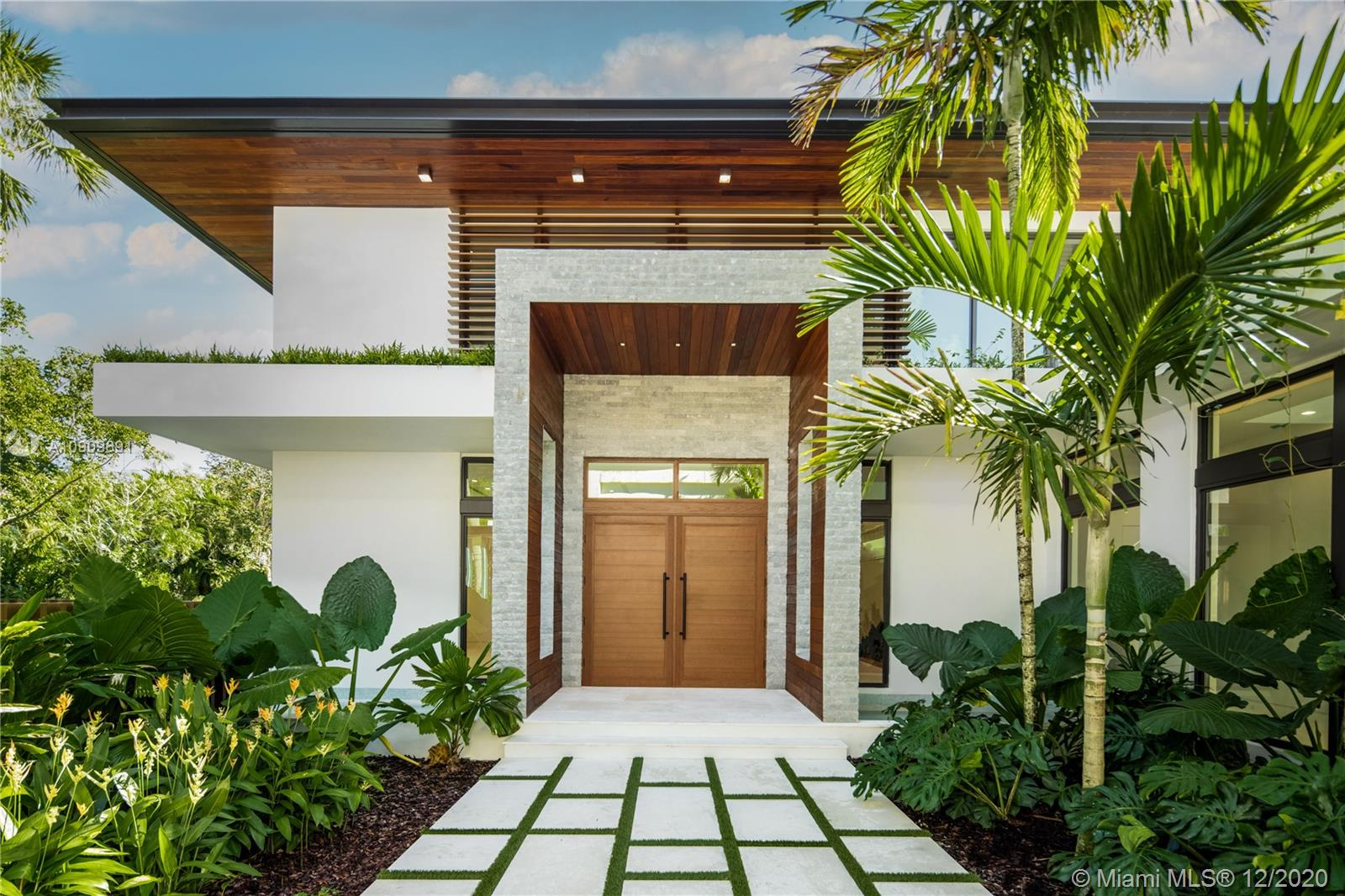 Introducing a luxury, personal resort in a premium location by a leading residential developer, Location Development. Designed by César Molina. This truly exceptional, high-quality residence embodies the Florida lifestyle, inside and out. The spacious floor plan highlights an indoor/outdoor lifestyle with large terraces, outdoor entertainment areas, and multiple bedrooms, featuring a master apartment and separate guest suite. A suite of thoughtfully-planned features and amenities that will provide incredible spaces to relax, entertain and experience the best that life has to offer. Complete home automation, wine room, media room, dedicated study, outdoor kitchen and fire pit, a lap pool, gym, hammam spa w/ steam room & hydrotherapy program. Garage fits up to 8 cars for an avid collector.
