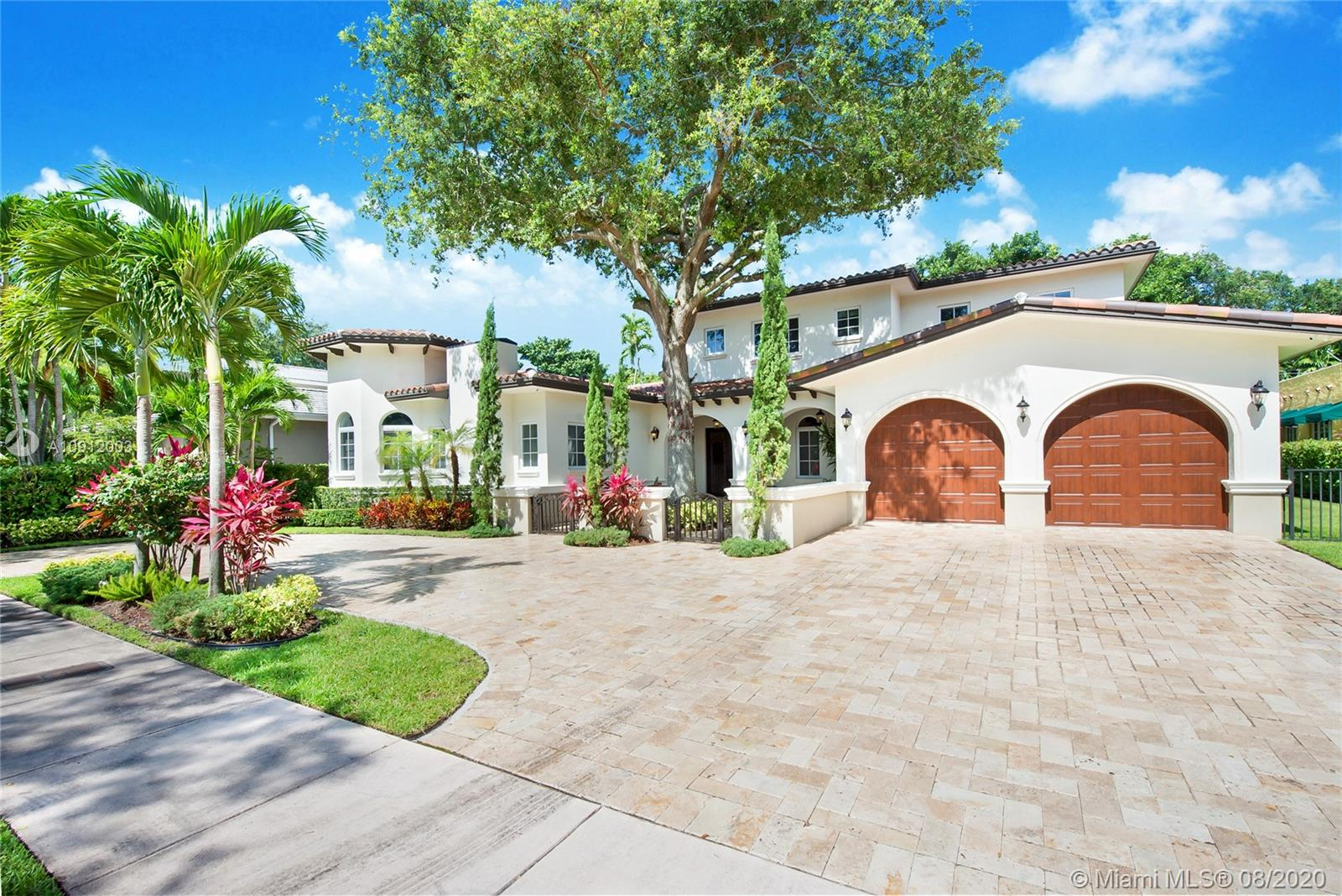 Spectacular one of a kind Home in the Heart of the Gables. Rare Opportunity to own this Gem on a huge triple lot. House boasts a beautiful courtyard entrance centered around a grand oak, circular driveway,2 car garage.Features 6 bedrooms, 6 and a half bath including a large downstairs den/office/media w/fireplace. Marble floors throughout & wood floors in bedrooms. Master suite upstairs w/2 large walk in closets, spacious bath suite & covered terrace overlooking the pool. Kitchen equip w/ Top of the line appliances include Wolf & Miele, oversized island & quartz countertops. Includes a Crestron sound system throughout, impact windows & doors, and grand ceilings. Formal dining room, family & living room that open out to covered terrace & pool. MUST SEE... NO EXPENSE SPARED...