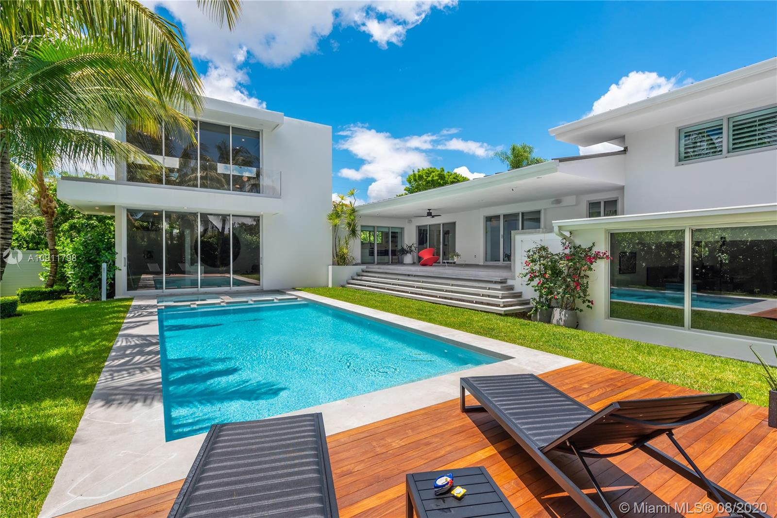 A piece of the Hollywood Hills in the heart of South Miami. Set on an oversized corner lot, This custom home was redesigned & reimagined by LUMINAIRE in 2019 as a timeless sanctuary for art collectors. Open entertaining spaces and retractable glass walls bring in an abundance of natural light during the day. Gorgeous pool and garden views expertly lit at night. Italian crafted Porro closets lead the way to the centerpiece of the home: a sumptuous two story Master Wing that takes living to new heights. Fully equipped with SMART home technologies, Sonos, & security systems, Leicht Kitchen with Sub Zero & Gaggenau Appliances, heated saltwater pool, fitness center, 2 car garage & motorcourt for the car enthusiast. Convertible 4th BED. Ideally located nearby top schools / business districts.