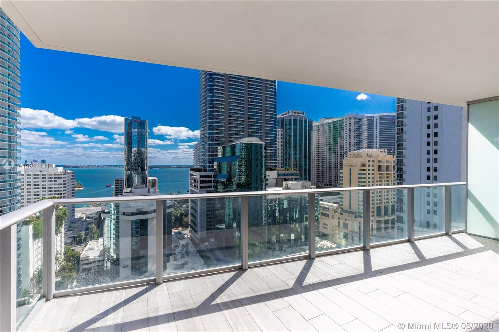 Fabulous 3 bed 3 bath 1,753 sq ft unit at the iconic 1010 Brickell condo featuring top-of-the-line modern finishes throughout, stunning panoramic views, wood flooring, modern chic kitchen, built-out closets, and baths with glass-enclosed showers. Plus, this unit comes with a two-car garage and an additional assigned parking space! Boutique amenities include: outdoor movie theater, restaurant, rooftop swimming pool, spa, hot tub, sauna, steam room, basketball court, racquetball court, running track, fitness center, party room, kids room, virtual golf simulator, ping-pong table, and more. Spectacular views of the bay and the city skyline, walking distance to Brickell City Centre and public transportation. Don't miss this chance to be in the heart of everything Miami has to offer!