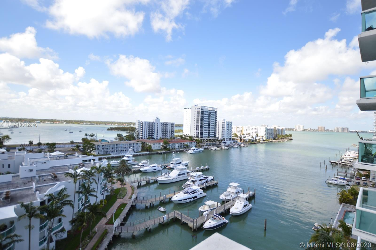 Live right in the middle of Biscayne Bay, not just facing it, at 360 Condo of North Bay Village on Harbor Island. This 2BD/2BA condo, w/a 1,251 SF split open floorplan, provides big views of the bay & its private marina through a wide bank of floor-to-ceiling windows and a long stretch of balcony space. The modern kitchen features stainless appliances, a dining counter, and wood cabinetry. The living areas are fresh and bright with pristine white tile flooring, while the bedrooms benefit from the warm, soothing effect of rich wood floors. Both bedrooms have marble baths and large closets. The amenities and advantages of this boutique condo building are abundant, incl. boat slips, bayside pool, 2 saunas, gym, 24-hr guarded gate, valet garage parking, quick beach & mainland access, and more.