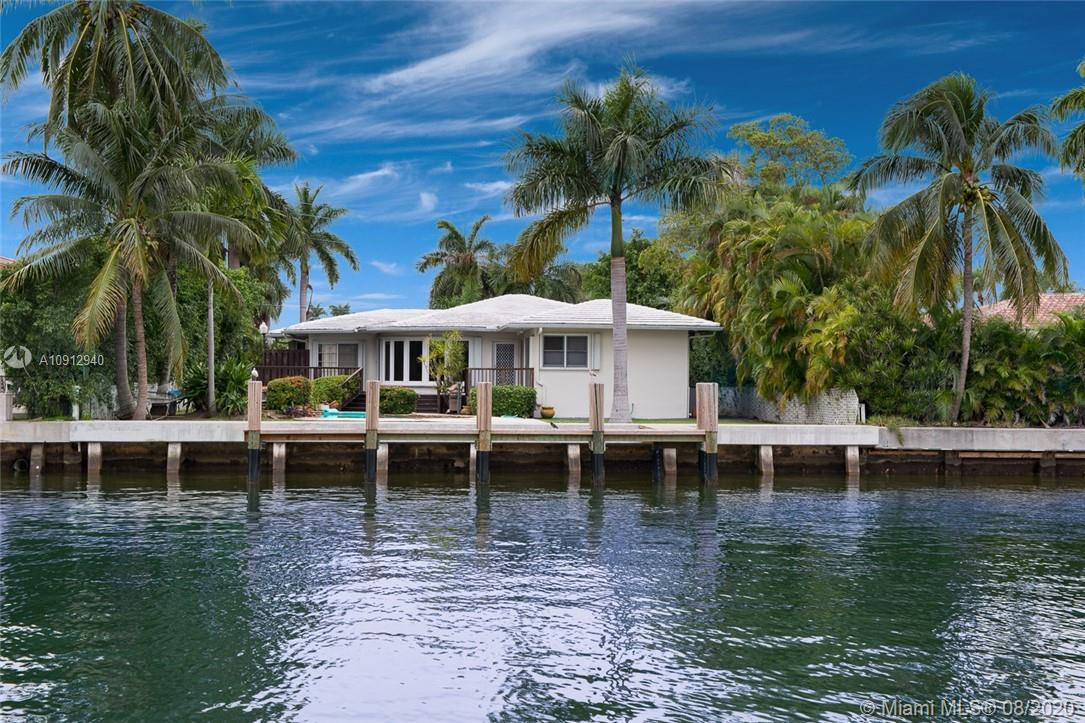 Renovate existing home or build your dream estate! Charming art deco family home in tranquil bay harbor islands. Featuring large eat-in kitchen with new flooring, sub-zero and viking appliances. Fully repainted inside and outside, cuban tile floor in living area, wood floors in bedrooms, great architectur al details, beautiful pool and jacuzzi and tiki hut perfect for entertaining outside. 2,800 sf as per owner. Dock your boat to a brand new dock and seawall, no bridges to bay. Price negotiable! Send your offer!