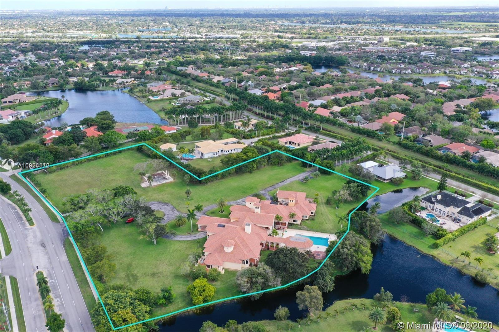 THIS MANSION IS ONE OF THE LARGEST AND HAS THE POTENTIAL TO BE THE MOST SPECTACULAR IN THE CITY OF WESTON. ENTERTAINERS PARADISE! 'EXOTIC CAR SHOW HOSTED ON PROPERTY/120 CARS STAGED ON DRIVEWAY/NOT ON THE FRESHLY MANICURED LAWN  6.3 ACRES; 14,294 SQ FT LIV; 19,269 SQ FT ADJ TON OF EQUITY FOR THE NEW HOMEOWNER! LUXURY FINISHES: GRANDEUSE 400 CAPACITY BALLROOM; THEATER; IMPACT WINDOWS; IMPORTED CUSTOM DOORS FR SPAIN; FULL SERVICE INTERIOR BAR WITH FIREPLACE; EXERCISE ROOM; CONTEMPORARY KITCHEN WITH HIGH END FINISHES AND APPLIANCES. LONG MAJESTIC HALLWAY; IMPRESSIVE CHANDELIERS; RESORT STYLE POOL WITH SWIM-UP BAR. FULL SUMMER KITCHEN; HALF BATHROOM AND OUTDOOR SHOWER. PLEASE CALL LISTING AGENT TO SCHEDULE SHOWINGS, DRASTIC PRICE REDUCTION, SELLER HIGHLY MOTIVATED!!!