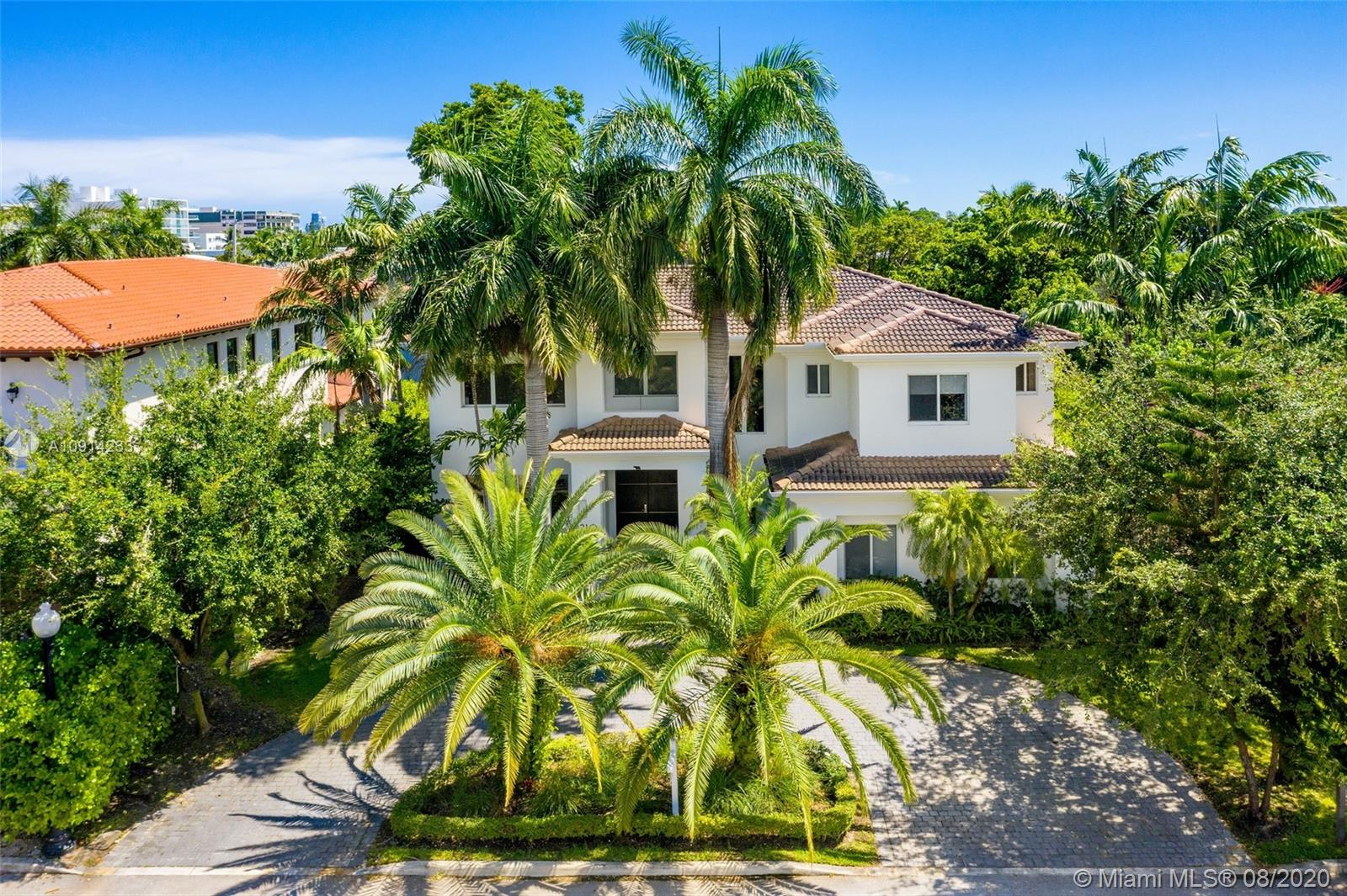 This gorgeous home in Bay Harbor Islands features 4,730 square feet of perfectly decorated detail. Walk through the grand entry to your living room with double volume coffered ceilings, gourmet eat-in kitchen, and family room that overlooks the pool and patio areas, with an overhang providing comfort for outdoor dining. The perfect flow of this 5 bedroom home is ideal for a large family, with a playroom, office with an en-suite bathroom, master suite with a large closet and terrace overlooking the pool. Walking distance to restaurants, beaches, shopping, A+ schools, and more.