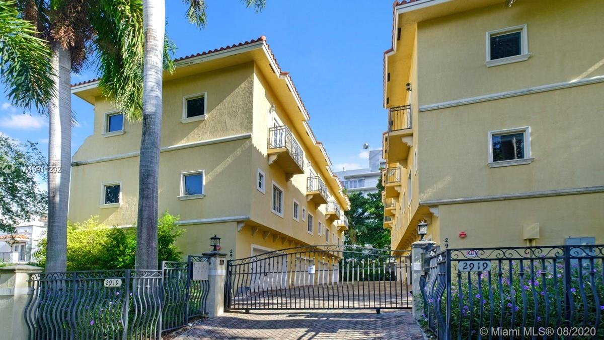 Lovely, tri-level townhome in a small gated community, just blocks from the Grove village center's galleries, boutiques, cafes and bayfront parks & marinas. Light-filled living spaces with Italian porcelain tile flooring & French doors that open to a covered balcony. European-style  kitchen features wood cabinetry, quartz countertops & new stainless steel appliances. Updated, modern-style bathrooms & impact glass throughout. 3rdlevel master suite + additional BR/BA. Ground level 2 car-garage with ample storage & washer/dryer. Low HOA fee of $320 mth.& pet friendly complex. Centrally located, just minutes to downtown, MIA, Coral Gables and the Beaches. High sea-level elevation (no flood insurance required). Pre-approval letter requested for all showings (Sat. & Sun.only - by appointment).