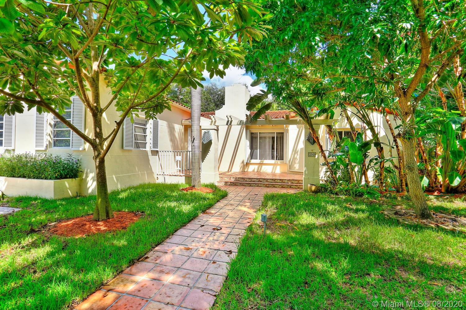 Lovely gated home on a quiet tree-lined street surrounded by a 10,339 SF garden with palms & shade trees.  Located just a short walk or bike ride to bayfront  parks  & marinas and close to the Grove village center's galleries, boutiques & cafes. Light-filled living spaces with beautiful hardwood floors, fireplace & vaulted ceilings. Updated custom kitchen features wood cabinetry, granite countertops & stainless appliances. 2BR/2BA main house + separate 1BR/1BA guest house w/ kitchenette. Ultra-private, tropical backyard with freeform pool, waterfall & expansive wood deck. Ample gated & street parking + room to park a boat. High sea-level elevation ( flood insurance not required ).Minutes to downtown, MIA, Coral Gables, Key Biscayne & the Beaches.
