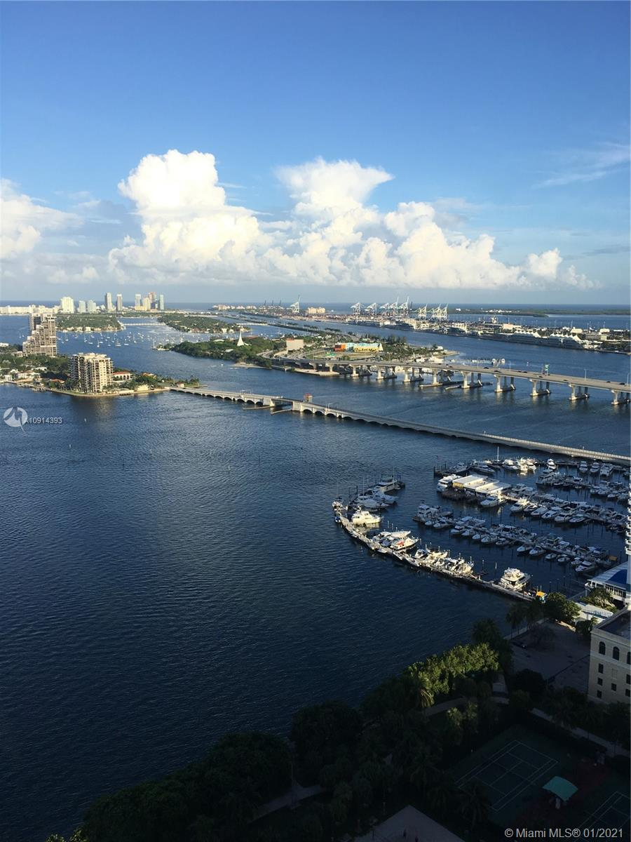 Four large balconies facing the bay with two parking spaces included. Amazing views of the Miami bay, beach and city. Across from Margaret Pace Park. Close to the supermarkets, cafes, restaurants and entertainment. Best line in the building with direct views t the bay.