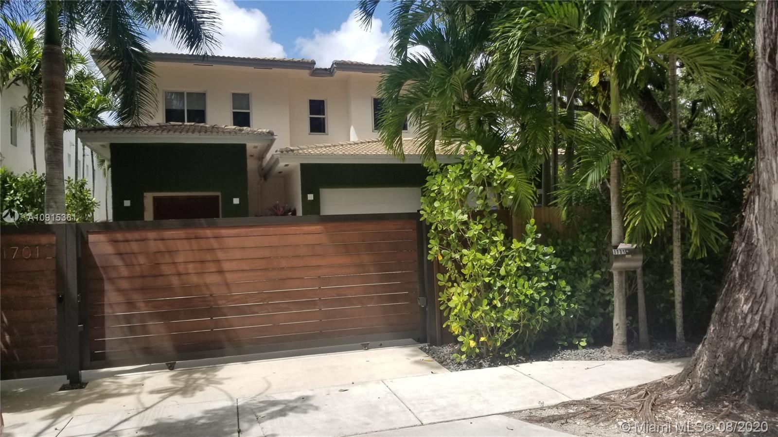Completely remodeled North Grove home located close to the best schools, Downtown Miami and Brickell,  featuring an open floor plan with high ceilings, marble flooring downstairs, wood in bedrooms, 5 bedrooms 6 bath with maid quarters plus Den.   totally remodeled kitchen with quartz counter tops and Italian Lacquered kitchen cabinets. Custom made wood cabinets,  sparkling pool, private roof terrace and  2 1/2 car garage. Corner home is completely gated in zone X no flood zone. Bring your pickiest buyer.