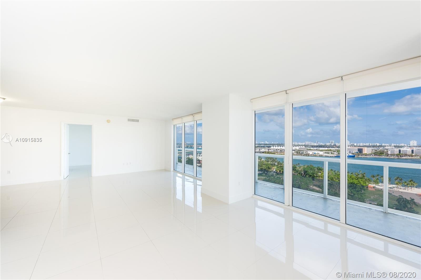 Spacious 3/2 corner unit with LARGE wrap-around glass balcony. Amazing Direct views of Bay Front Park, Miami Port, South Beach, Key Biscayne and Fisher Island. UPGRADED, marble floors, Italian kitchen: stainless steel appliances. INCREDIBLE amenities include: gym, Pilates, spa, heated pool, formal and informal club house, 24-hr security, door man, valet service, concierge!
