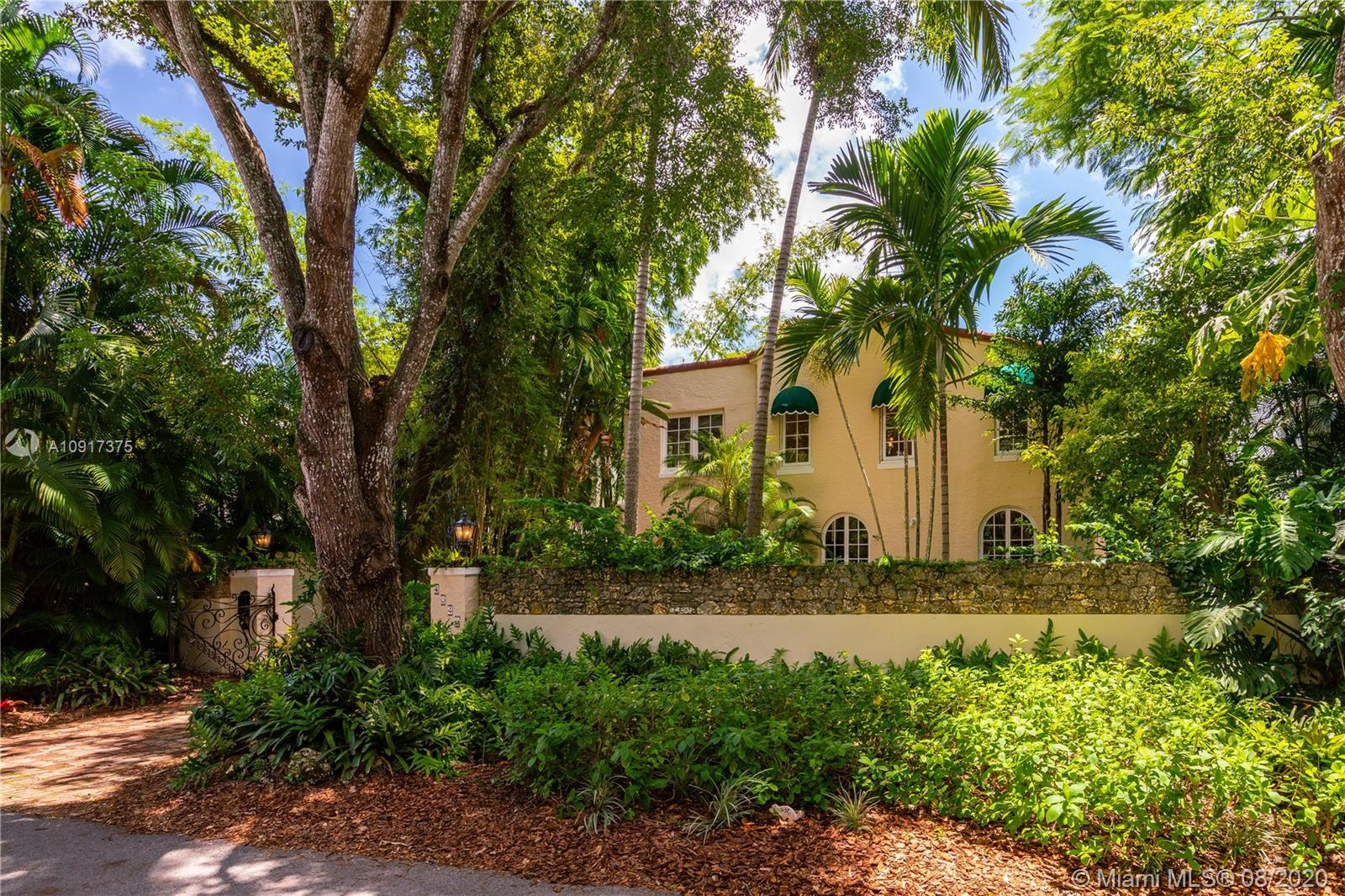 Classic beauty reverberates from every corner of this 1926 Mediterranean home in the coveted section of  South Coconut Grove. Enter through the gates to the Chicago brick driveway and luxuriate in the lush landscaping, lovingly planted by a master gardener. The charming and authentic living room welcomes with arched windows, fireplace, and original hardwood floors. The versatile 4-bedroom layout also includes a den and a bonus room which works perfectly as a playroom or at-home-learning space. The generous second floor main bedroom includes a fireplace and deck overlooking the pool which is a veritable Garden of Eden, adorned with a mosaic-tile fountain. Updates include new plumbing. This stunning property is part of the Utopia HOA. A Very Special Home.