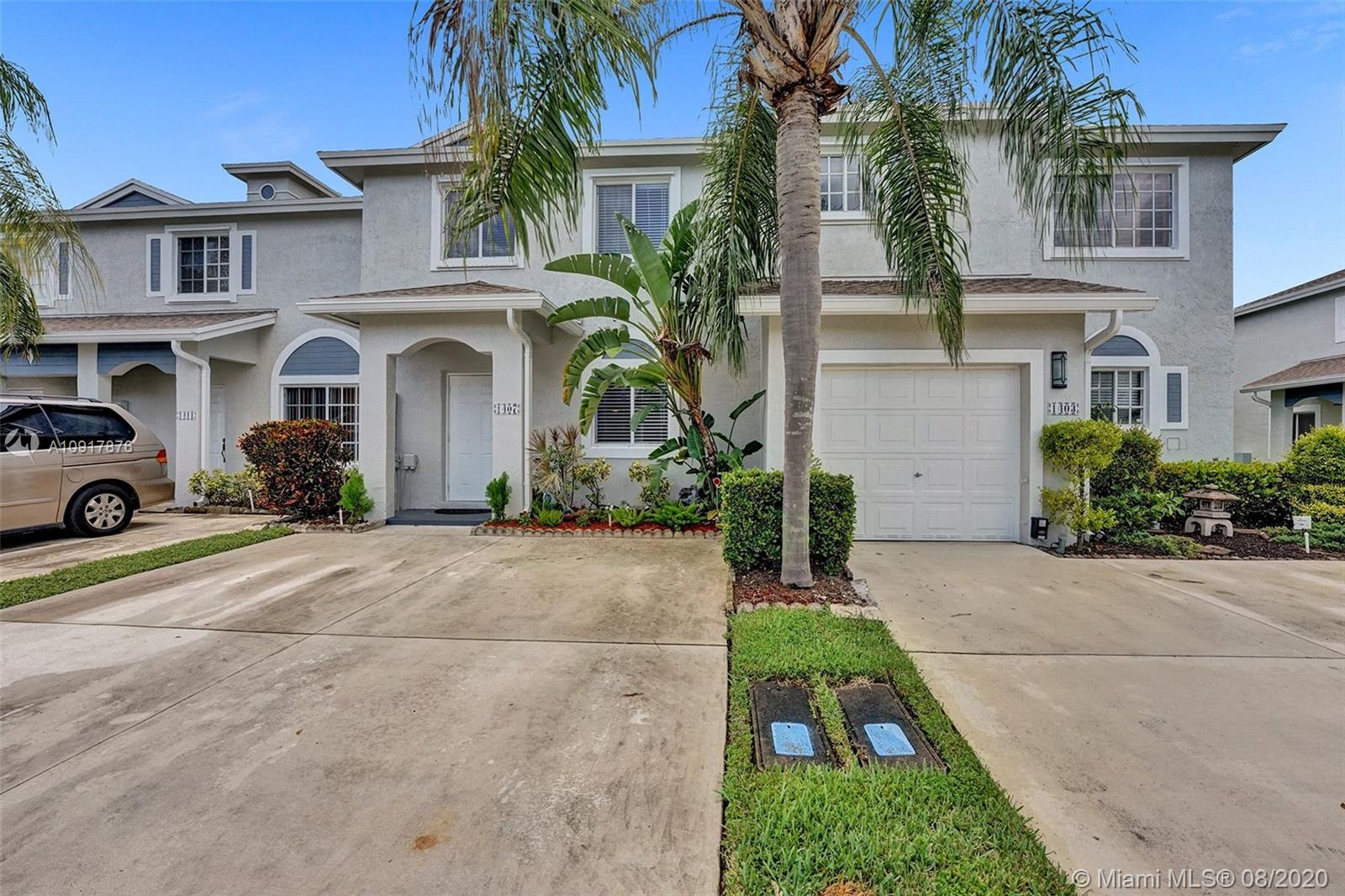 Spacious 3/2.5 Townhome in Heron Landing with eat-in kitchen, pass thru bar counter, updated tile and wood floors, walk-in close in master bedroom, full size W/D, 2 car driveway pad, gated community with live guards, newly painted walls, upgraded light fixtures and ceiling fans, screened in patio, large pets are welcome, crown molding — no dated popcorn ceiling, Updated powder room,Extra storage under the stairwell and outside storage room, quiet patio and outdoor area, perfect for backyard barbecues.Two clubhouses,two community pools, two tot lots, onsite fitness center , walking paths — perfect for jogging, lake views, plenty of community spaces to enjoy sunny South Florida, 24-hour staffed guard gate, pet stations, strong sense of community.