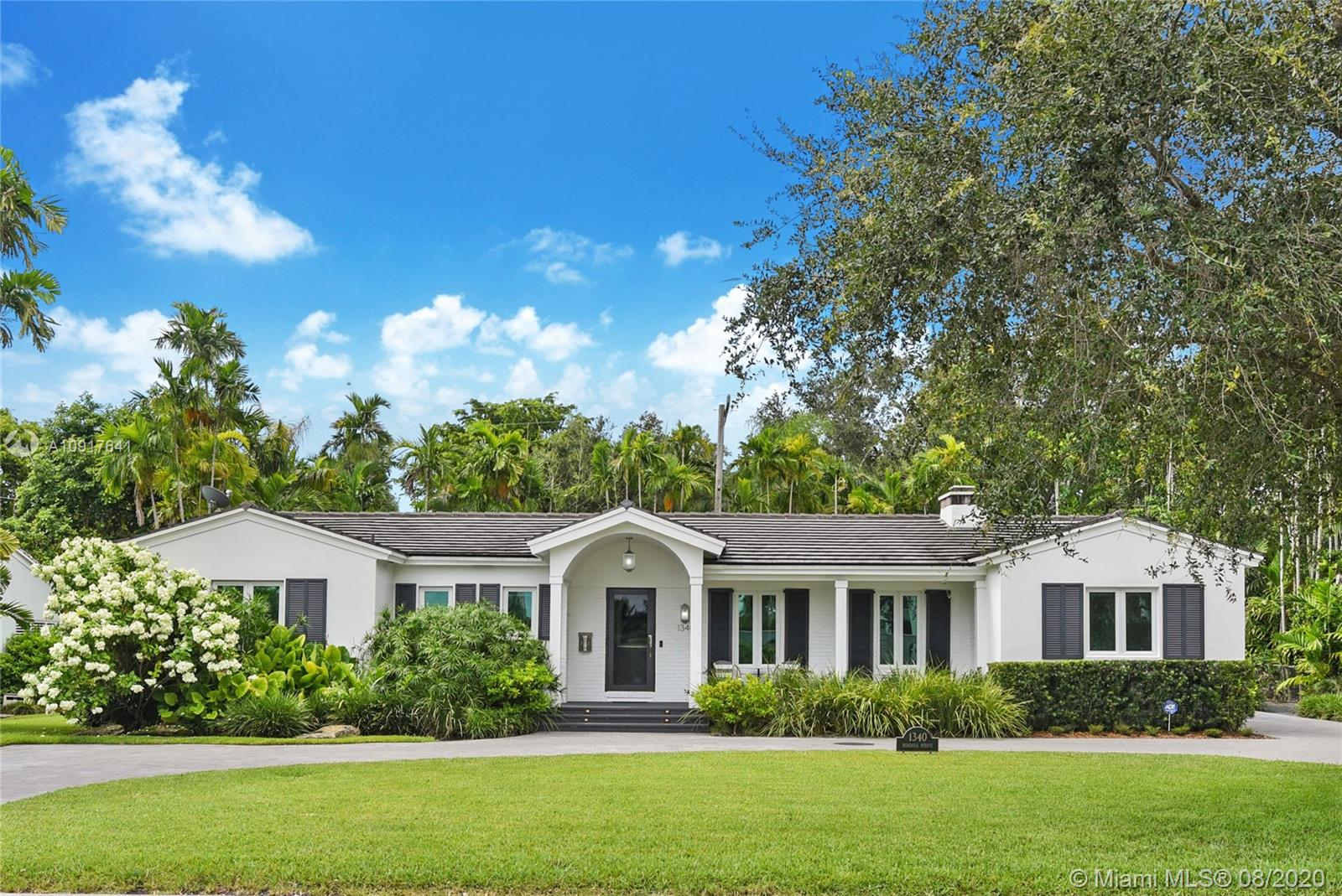 Gorgeous mid-century home overlooking Riviera Golf course with views of The Biltmore Hotel just west of Santa Maria Street. Completely remodeled, this 2019 Coral Gables Tour of Kitchen's home is a chef's dream: custom cabinetry; large island; Sub-Zero and Wolf appliances. Kitchen is fully open to family room with views of the lush backyard paradise -pool and spa. Hardwood floors throughout, large bedrooms and designer finishes. Expansive master suite includes marble bathroom, dual vanity, double rain shower, walk in closet and dedicated shoe closet. Separate office with two built in desks for working from home or virtual school. Impact windows and doors, 1,000 gallon underground propane tank, security system, and circular drive with parking for up to 10 cars.  Walk to Riviera Country Club.