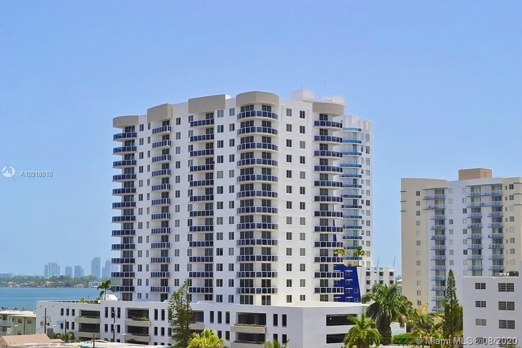 This amazing one bedroom and one bath unit at 23 Biscayne Condo. Miami Beach skyline and direct bay views. modern kitchen, stainless steel appliances, cherry laminate wood floors, granite countertops, and Berber carpet in bedrooms. The building offers a pool, gym, and a social room.