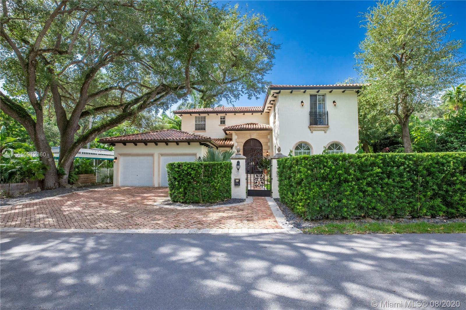 """Italian grandeur reminiscent of a sunny Tuscan villa sits on large lot in South Coconut Grove. Loquat is a favorite quintessential tree lined Grove street that is central and close to all your favorite spots. Exquisitely tasteful 6 bed/5.5 bath open plan """"pumps up the volume"""" w/ dramatic high ceilings and coffered detailing. Art collectors will love the spacious walls! Upstairs has master w/ large balcony plus 3 bedrooms all w/ en suite baths and WICs. Downstairs has two additional bedrooms. Wide open living spaces allow for beautiful and comfortable natural light that grace the home all day long. Backyard boasts covered patio, large pool,and lots of green space. 2 Car Gar. LA SF is 4635 per appraiser. Effective age of home is from 2005 w/ small portion downstairs originally built in 1940."""