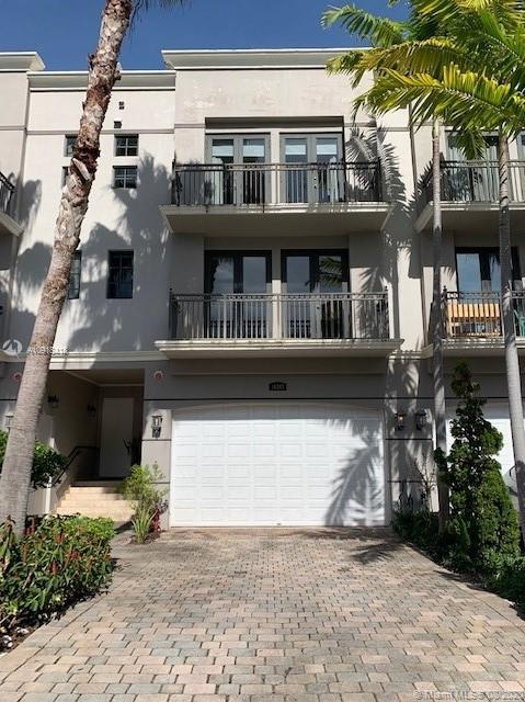 Inviting you to come visit an exquisite property.  It is located within a small Bay Town on the North End of Miami Dade County Beach that borders the Villages of Bal Harbor and Surfside.  Bay Harbor Islands, the best kept secret, is the Island you will fall in love with.  This four level townhome features a large entry foyer which leads to the Elevator, One Bedroom/One Full Bath and private open Patio, Second Level is a dream with an open layout of the Formal Living, dinning, family, kitchen (Quartz Counter Tops/Mahogany Cabinets & SS App and trims), Washer & Dryer, Balcony and full bath, Third Level: Master Bedroom/Bath & balcony, two bedrooms and one bath, Fourth Level: enclosed Elevator Access, Large Roof Top Terrace with Jacuzzi & beautiful Bay Views! Please contact the LA for an appt