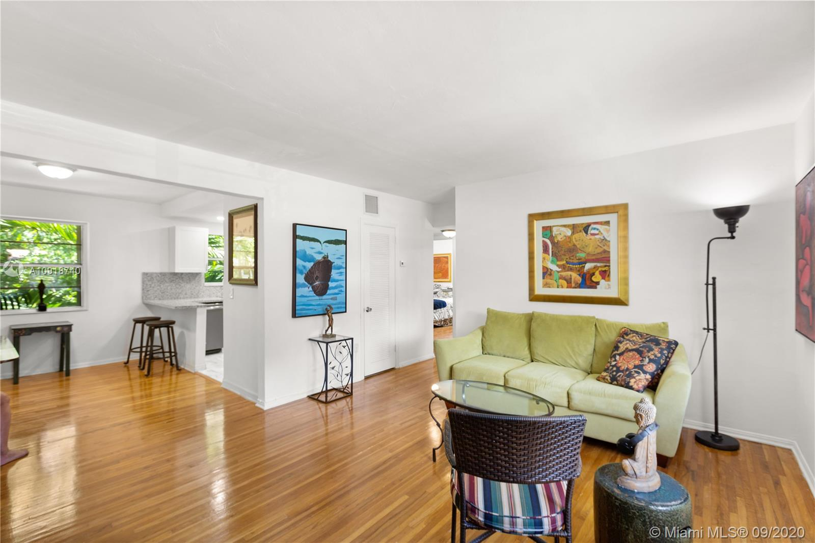 Lush, tropical vibes welcome you as you  meander through the hidden gem that is Pathways Condominiums. With a beautiful pool and picnic area, it's an easy place to unwind. Located on the second floor, this impeccable 2/1 impresses with Dade County Pine hardwood floors, bright light and a recently renovated kitchen. The new AC and updated laundry are sure to please. Moreover, its world class walkability means Sunset Place, the University of Miami and Downtown SoMi are all a short stroll away.