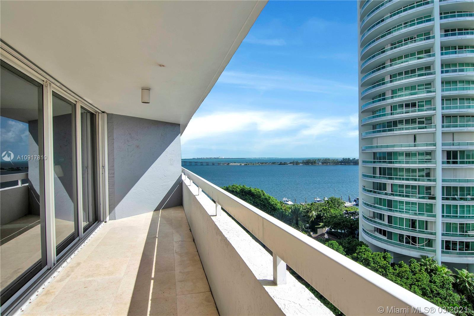 Contemporary design with style & sophistication. completely remodeled. spacious layout. over 600sq.ft. wraparound balcony w/spectacular panoramic city & bay views to enjoy the Miami sunrise/sunset. Floor to ceiling glass sliding doors provide balcony access & views from all rooms. Marble floors in living/dining areas & throughout balcony. Carpet floors in all bedrooms. surround sound w/Bose pre-wire speakers in kitchen, master & living, home theater in 3rd bedroom & wine cooler included in the sale. Amenities include a tennis court, swimming pool, jacuzzi, BBQ area by the bay, gym, concierge, convenience store, party room, valet.