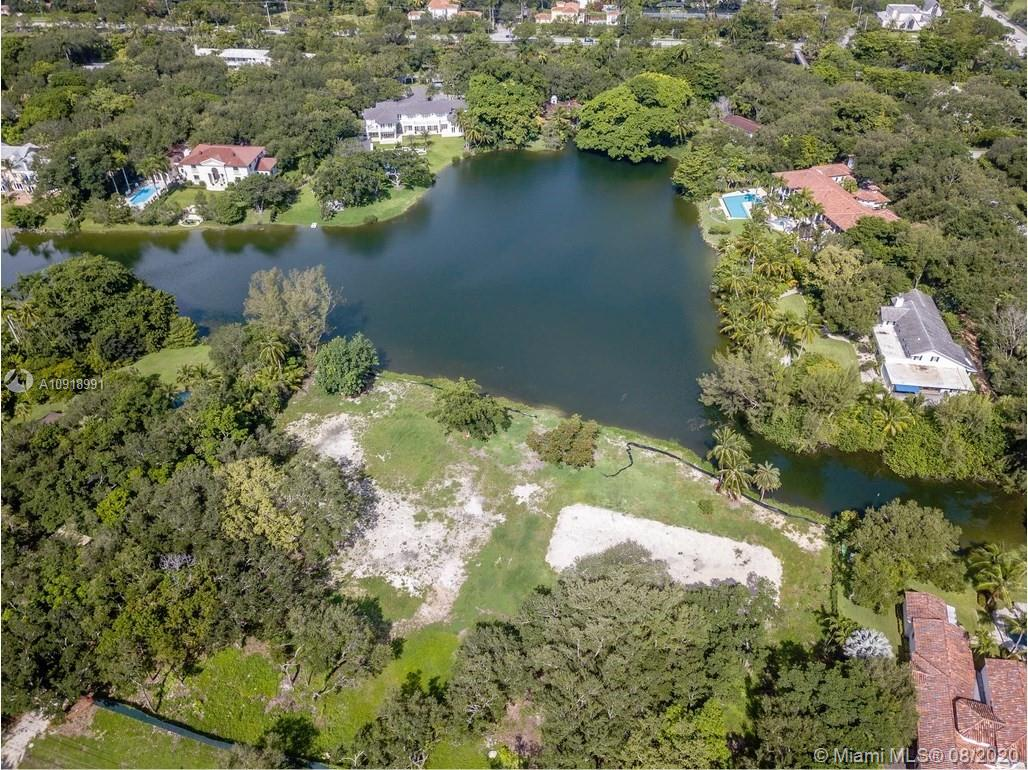 57,499 SF RECTANGULAR LOT ON WIDE WATER IN EXCLUSIVE SNAPPER CREEK LAKES. 24 HOUR GUARD GATE SECURITY AND ROVING GUARDS. STEPS FROM THE SNAPPER CREEK LAKES MARINA. BUILD YOUR CUSTOM HOME ON OVER 1.3 ACRES AND ENJOY WIDE WATER SUNSET VIEWS FOR A LIFETIME.  LOT BOASTS UNOBSTRUCTED LONG VIEWS OF THE LAKE AND CONTAINS OVER 35 MATURE OAK TREES. LOT HAS BEEN CLEARED AND IS READY TO BUILD. VACANT UNDEVELOPED LAND.  OWNER/AGENT.