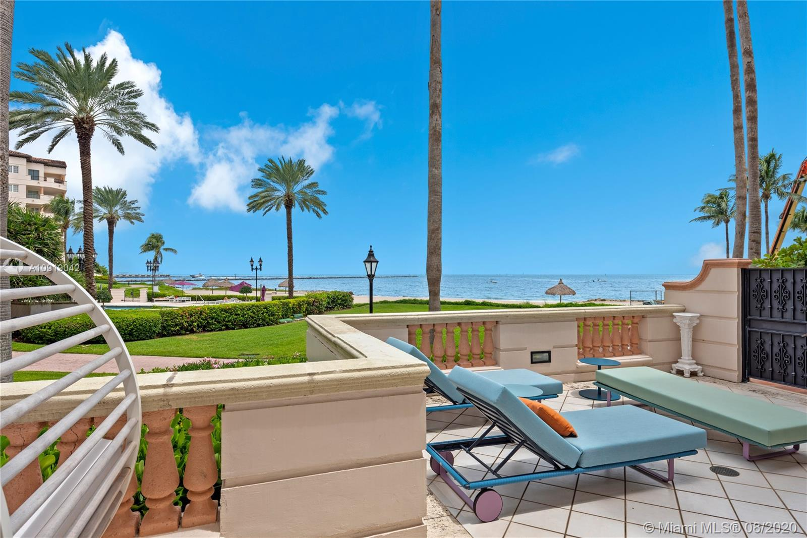 Unique ground floor corner unit. Private beach steps away from your door. Unobstructed ocean view.Renovated 4bed/3.5bath 3,580 sf. oceanfront residence. Expansive wrap around terrace. No expense spared on renovation, custom built non toxic high end finishes, living edge mirrors, custom built in jellyfish aquarium, hidden bookcase doors. The 2nd and 3rd bedrooms are good size with full en-suite renovated baths and ample closet space. All bedrooms have their own private door out to the terrace. Spectacular ocean views from living room, dining room, den and kitchen. Brand new custom appliances. Fisher Island amenities include world class golf, tennis, marina, beach club and more.