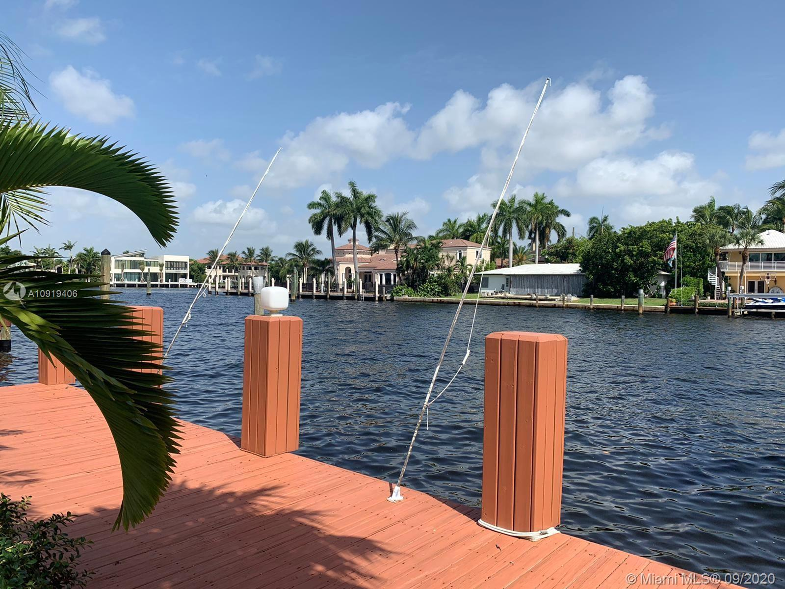 """BEAUTIFUL HOUSE , 200 ft wide canal Newly remodeled """"Magazine Quality Home"""" Wide water and intracostal views 3/3 1/2 /2cg pool , new dock, 2900 sg ft, lush landscaping walk to the beach,courtyard gated entrance,foyer entrance ,open great room, french doors open to the cove red marble patio and pool area with amazing views, new designer kitchen ,granite counters ,formal dining room,3 bedrooms in suite designer baths,split floor plan,plus guest 1/2 bath , inside laundry room, HIGH IMPACT WINDWOWS Private gate to park and Beach access BEST PRICE FOR A QUICK SALE dont miss This opportunity 40 FT DOCK"""