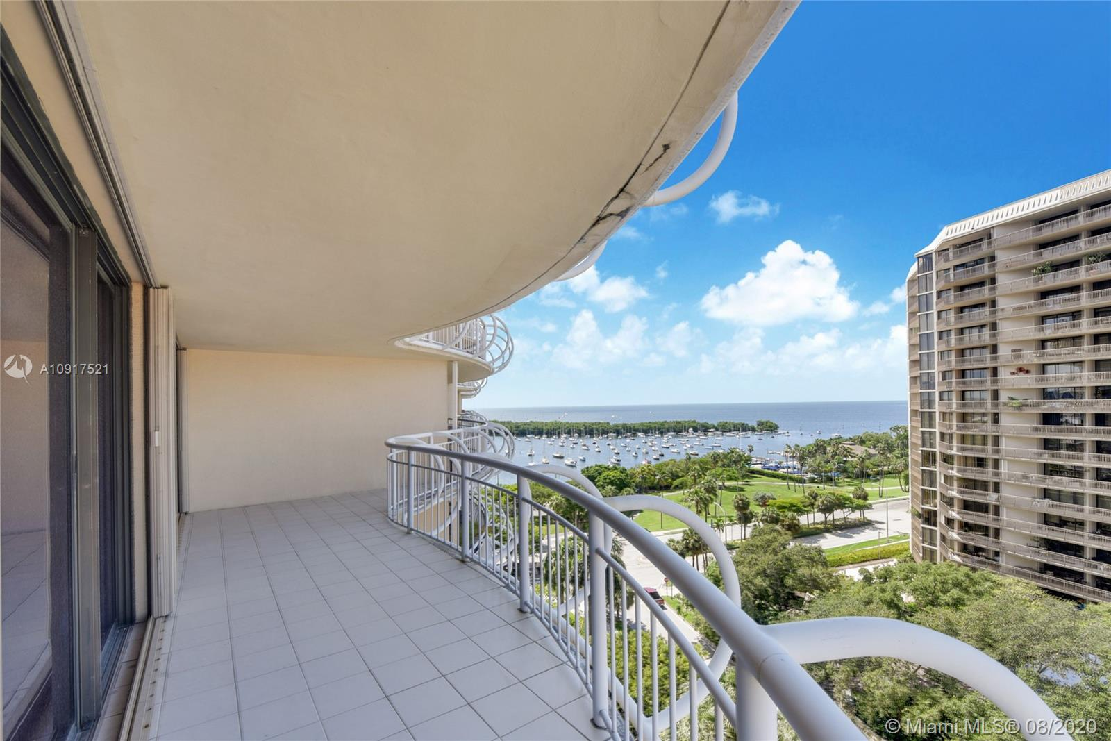 Live in the heart of the Grove village overlooking Sailboat Bay, in these charming 2 bedrooms, 2 bathrooms with 800 square feet of wraparound balconies to entertain or just relax!!! Walking distance to marinas, restaurants, shopping, Fresh Market, movie theater, and more. Grove Towers is a prestigious, full-service condo bldg. with a spectacular swimming pool, 02 tennis courts, spa, updated gym with all new equipment, valet parking & 24h concierge. Grove Towers is truly a prestigious, full-service condo bldg. This is the BEST PRICED UNIT IN THE BUILDING!!!