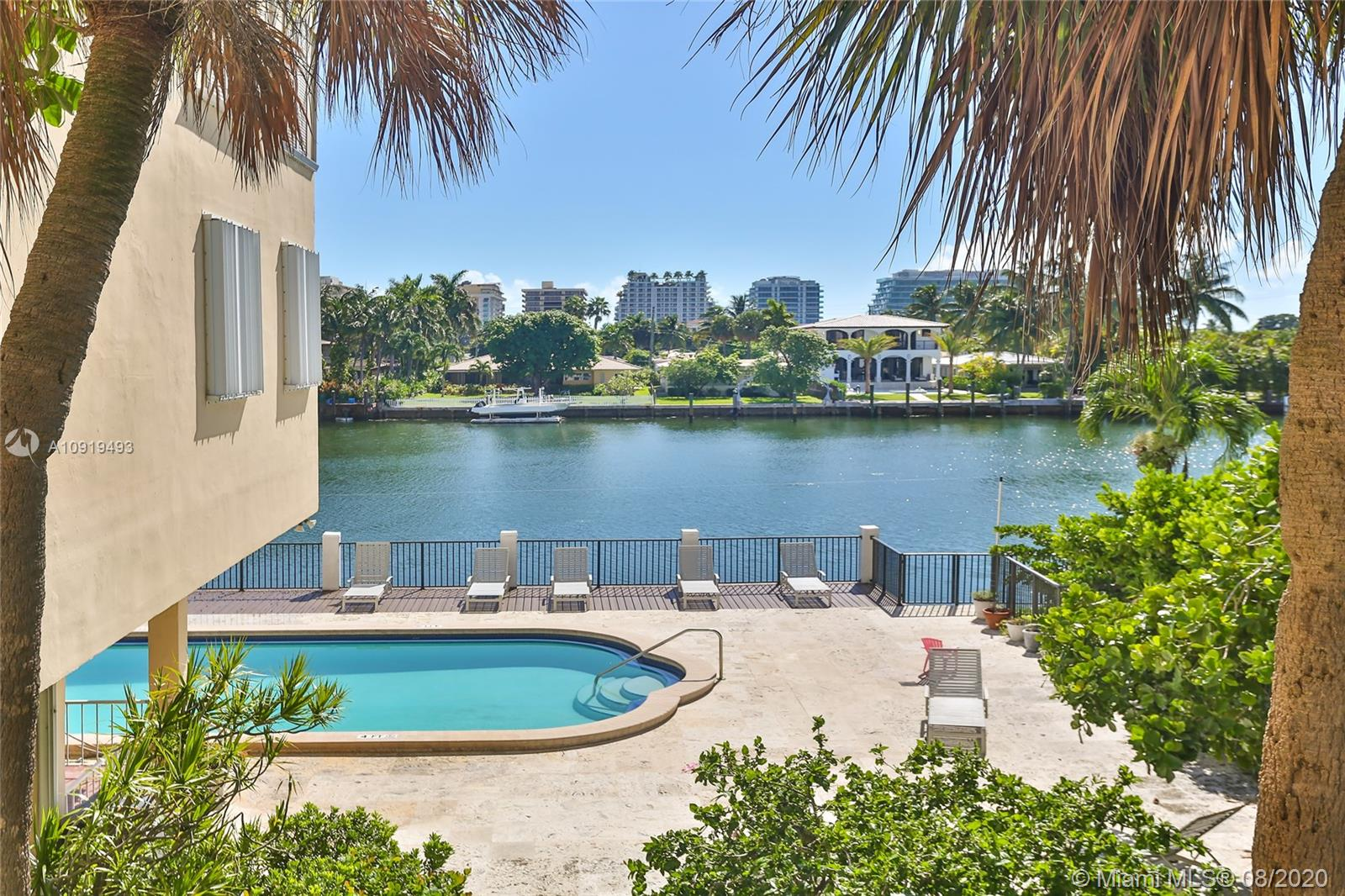 Truly a gorgeous condo with a great floorplan for sale at the Granada in Bay Harbor Islands! Bright, airy & open living/dining area with hurricane-impact sliding glass doors leading out to a private balcony with a direct water view. Conveniently located on the second floor surrounded by lush tree greenery. Beautifully renovated kitchen with wood cabinetry, granite countertops and Kitchen Aid stainless steel appliances. Tile flooring in the living areas and wood floors in the bedrooms. Both bedrooms have full en-suite bathrooms & large closets. There is also a half bathroom and an additional storage unit. The Granada has a waterfront pool & assigned parking. Walk to the beach, shops & restaurants. Zoned for Bay Harbor elementary & middle schools. Dogs are not allowed and renting is limited.