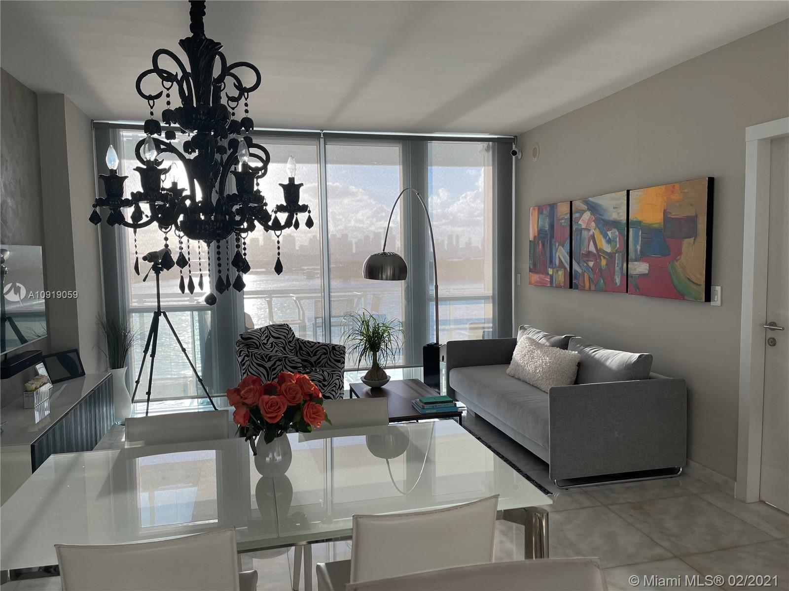 Beautiful and impeccable waterfront condo w/ the most breathtaking wide open bay/waterview and Miami Skyline view. White marble floors thru out and tastefully furnished. Move right in and enjoy the sunset every night. Best location! Walk to all the shopping, beaches and restaurants in the S of 5th street area.