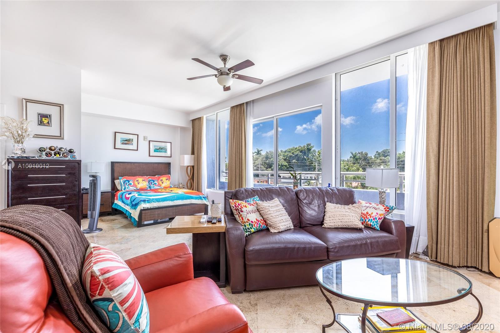Live Work Play in Coconut Grove!!! Enjoy all the parks, cafe's, nightlife the Grove has to offer within walking distance of your new Condo.  This Boutique Bldg in the Heart of Coconut Grove with Rooftop Swimming and Patio great for entertaining or for a refreshing dip after those long beach days.  What else can you ask for centrally located in the Coconut Grove. Large spacious unit with floor to ceiling windows, volume 10 ft ceilings, Balcony, Marble Floors, 2 Full Bathrooms, walk in closet, pet friendly,  Assigned Garage Parking, Washer and Dryer, Updated Kitchen and Baths.  Come check it out and star enjoying your new lifestyle.. Call/Text LA for showing. See you at Monty's;)