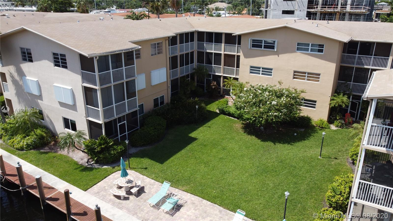 This updated 2/1.5 corner gem has a spacious floor plan that opens to the large, screened balcony from the living areas and one of the bedrooms.  It has plenty of storage space and relaxing views of of the dock, canal and green spaces.  Quite entertaining to watch the yachts go by!  The amazing location is just down the street from the 15th Street Fisheries, Cooley's Lading with boat ramp, Lauderdale Marina and water taxi.  It is also close to many restaurants, shops, Port Everglades, the airport and downtown Ft. Lauderdale.  Immediate rentals anywhere from 3 to 12 months are allowed making this a either a great place to live or a good investment.  Dock spaces availability is on a first come first serve basis and managed by the condominium association.  Storage cage a possibility.