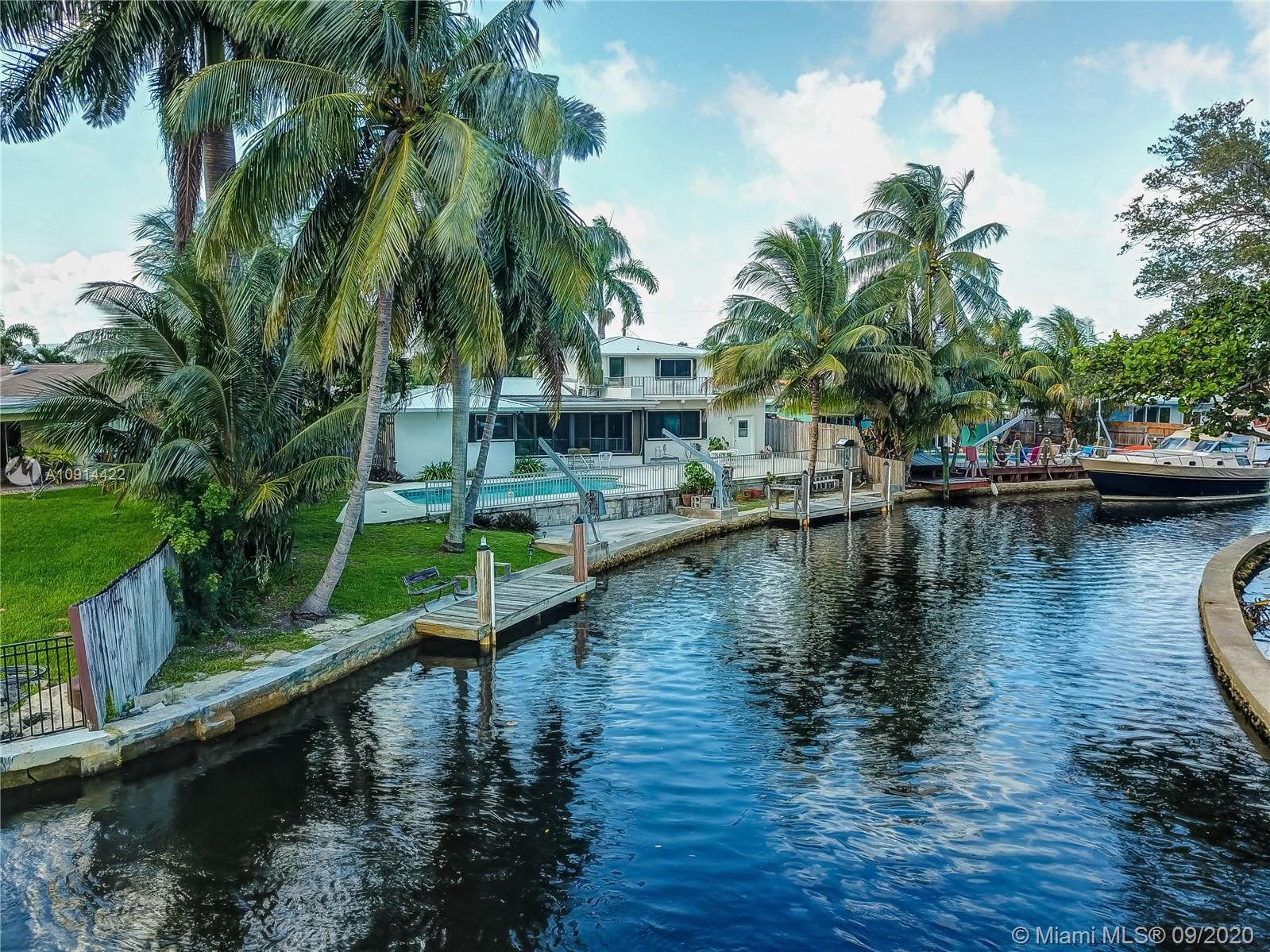 Commandingly situated on a sprawling lot in coveted Melaleuca Gardens, this transcendent waterfront oasis delivers a boating enthusiast's dream come true. Boasting 99 feet of prized water frontage on tranquil Dania Cut-off Canal, the home is perfectly positioned for elevated living at its finest and sets the stage w/ an array of lush coconut palms, an invigorating pool, an expansive pool deck, a second-floor sun deck, and attached workshop. Sparing absolutely no detail, the home comes fully equipped with hurricane windows and doors, recently installed in 2017, accordion shutters, and a hard-wired Generac Generator for added peace of mind. Idyllically situated, you'll also enjoy unparalleled proximity to a tantalizing range of shops, restaurants, entertainment, beaches, & so much more.