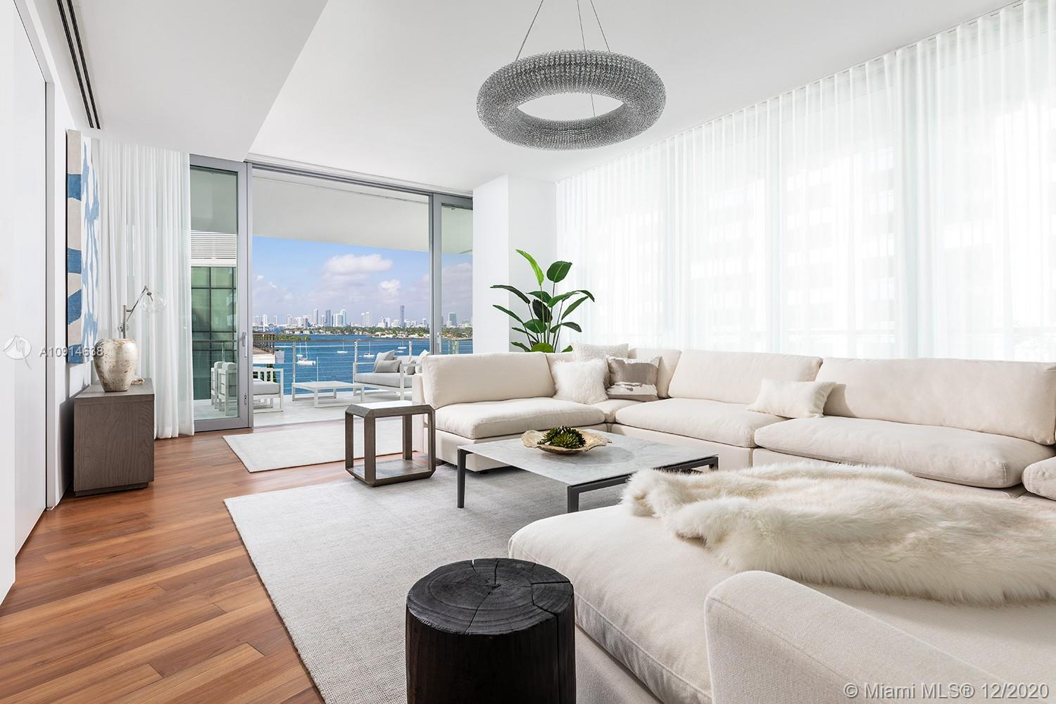 Composed of 59 individually designed residences around a glittering lagoon, Monad Terrace by Pritzker Winner, Jean Nouvel, provides brilliant light, private outdoor space, climbing gardens, unique sawtooth honeycomb facades & stunning sunset views of Biscayne Bay. Interiors are finished with marble bathrooms & kitchens, custom cabinetry & built-in features, designer fixtures, teak flooring throughout & private elevators. Estimated delivery in 2020. Images are renderings or Model Photography.
