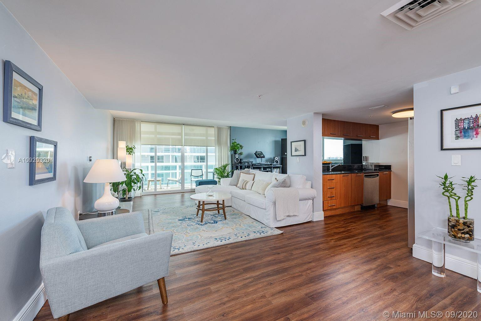 Bright and spacious corner unit in the top level of its line at 1800 Club in Miami's Edgewater neighborhood. Featuring 1800 square feet of living space and 200 square feet of patio space spanning separate balconies: gorgeous urban sunsets on one side, with the other postcard-worthy serene bay and ocean views. Huge 34' by 13' great room beams with natural light and offers multiple setups for living, dining, and den areas and multilayered privacy blinds and curtains, with easy access to the open kitchen which has granite countertops and stainless steel appliances 2 large bedrooms have attached bathrooms, and large equal-sized walk in closets with beautiful cabinetry and shelving. In addition to walk-in, master bedroom contains separate office area with desk and shelving.